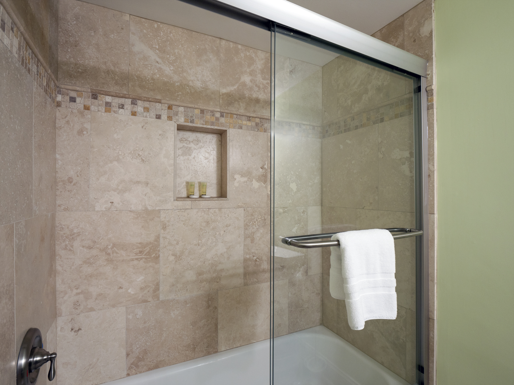 Tiled master shower with tub