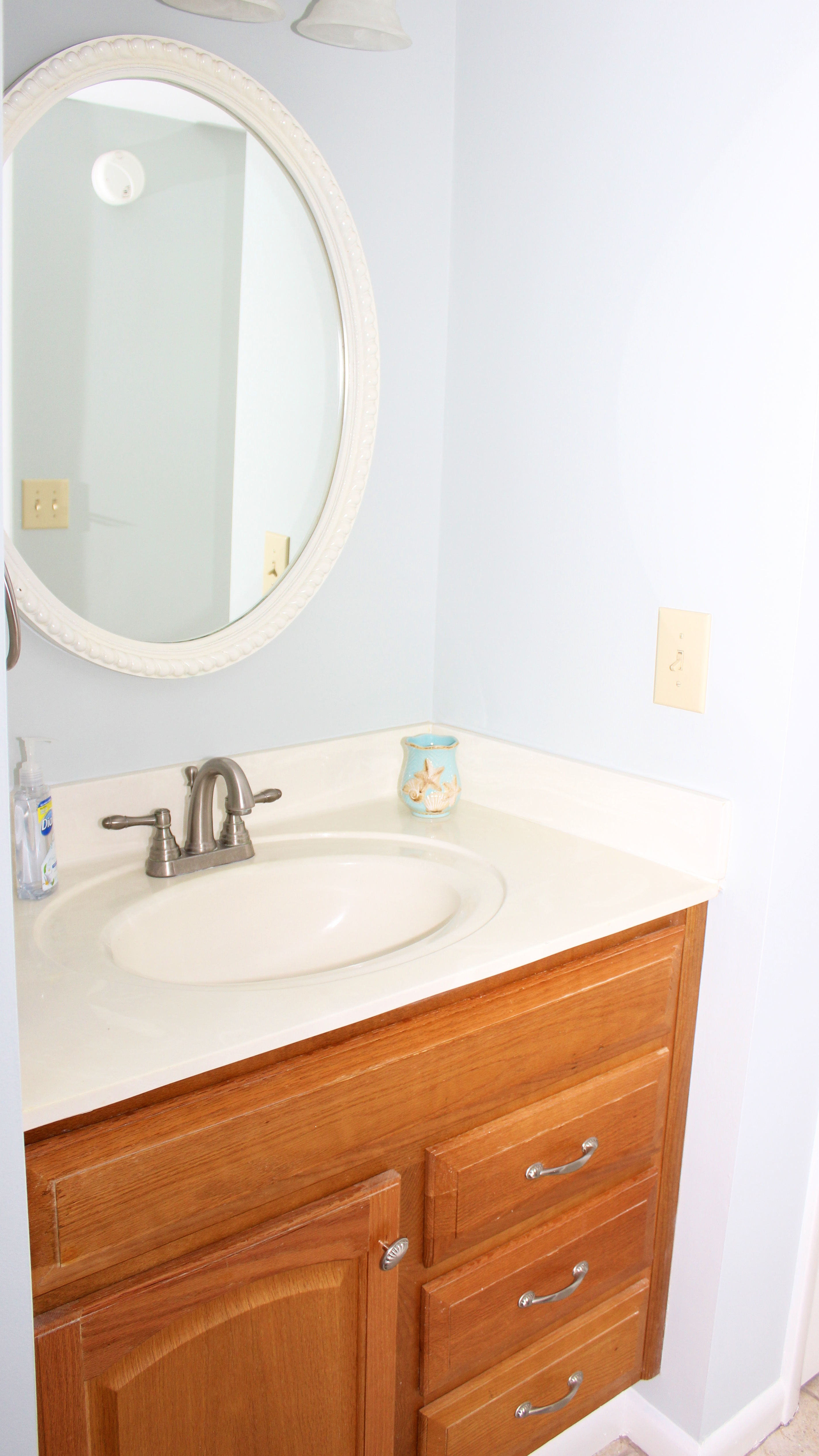 There is a separate sink area in the adjoining bath.