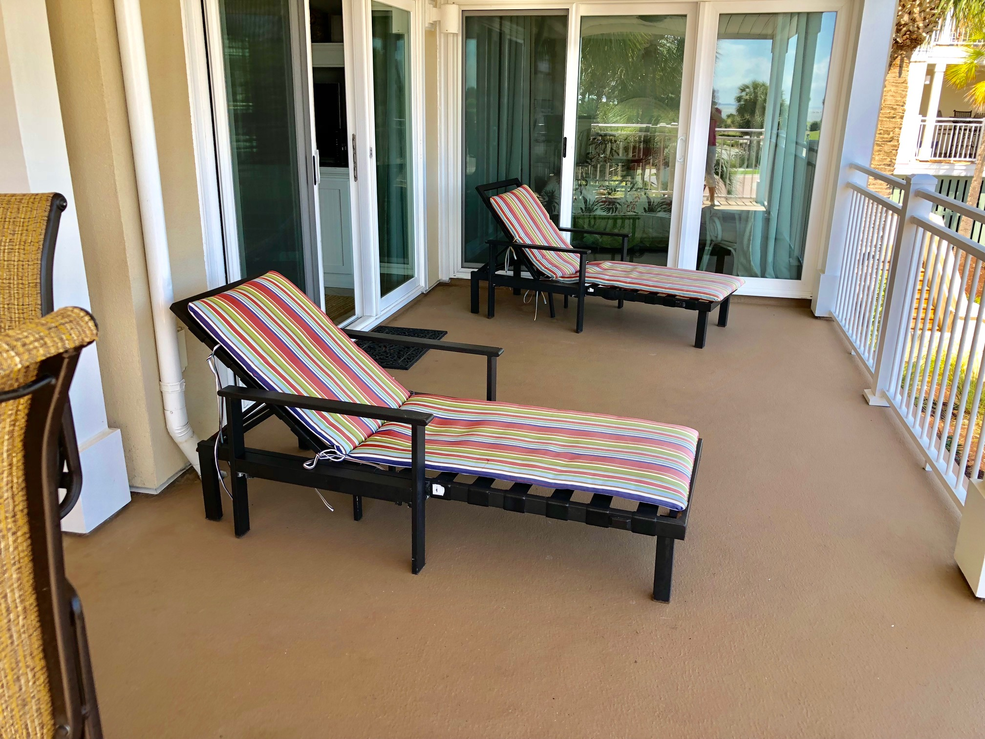 Spacious deck with chaise lounges and high top table to enjoy the view.