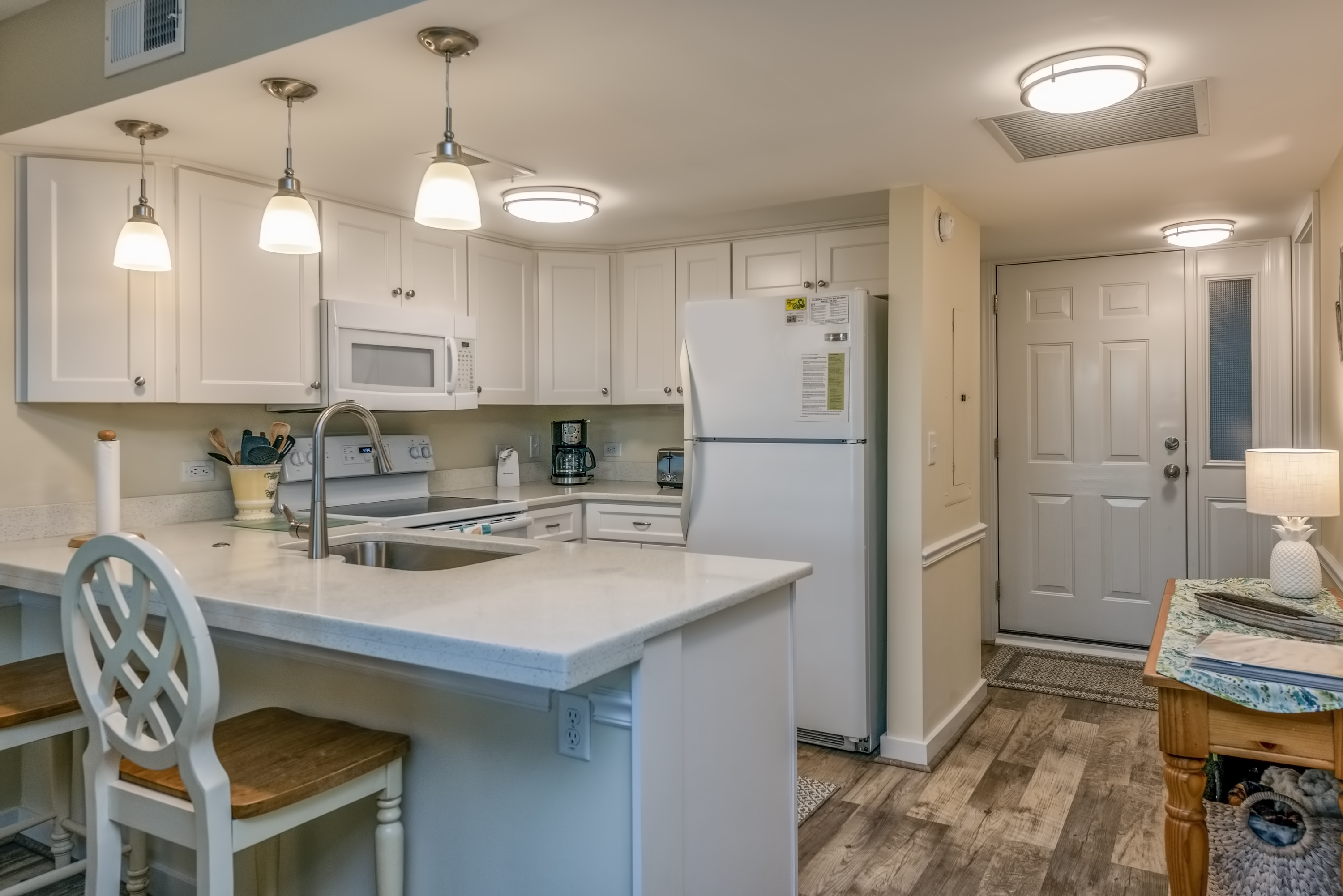 newly renovated kitchen with granite countertops, new cabinets and light fixtures.