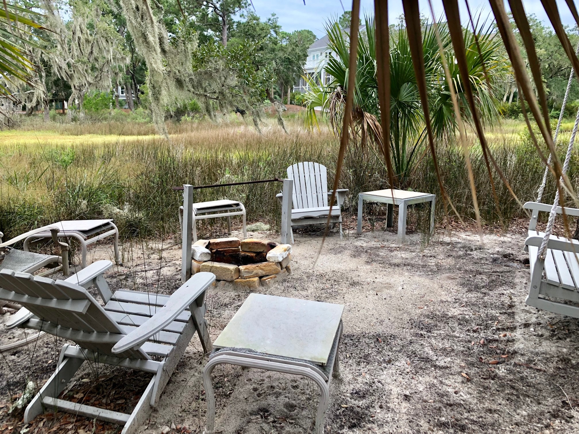 Fire pit adjacent to the marsh
