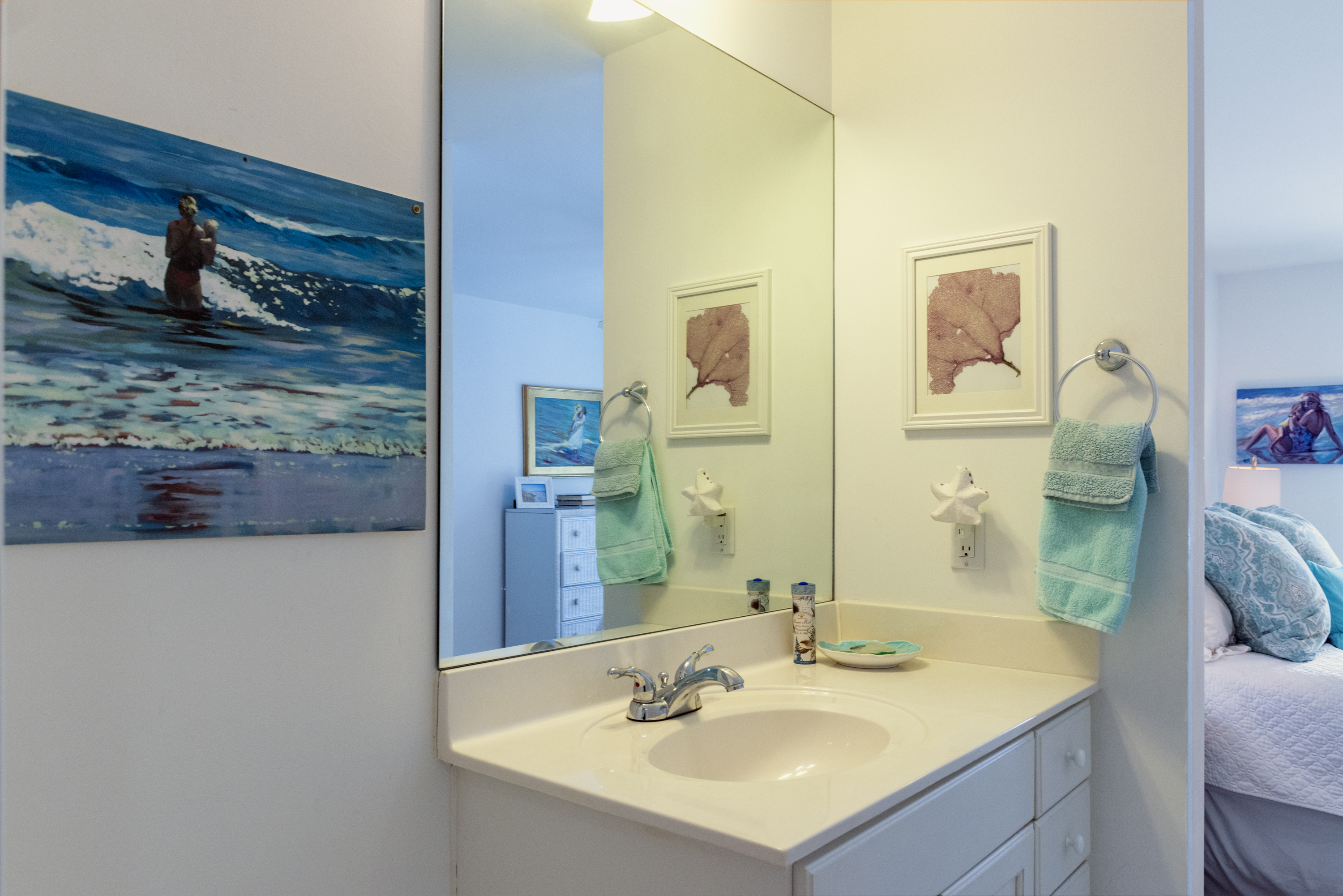Separate vanities with shared tub/shower, toilet