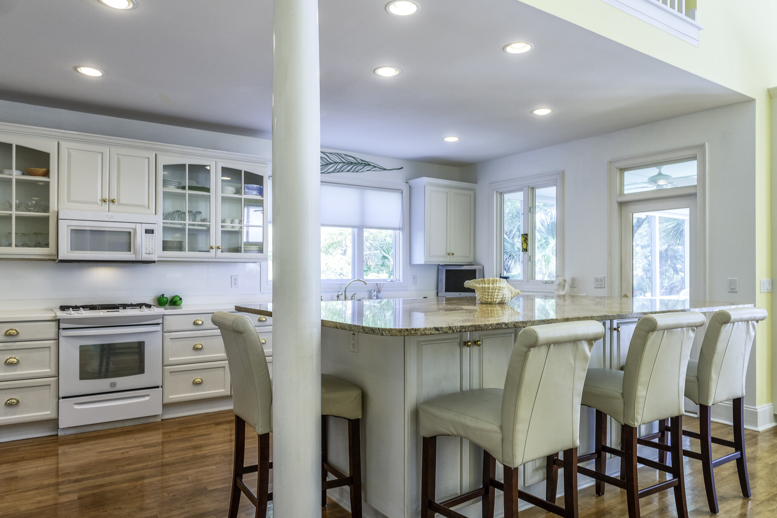 Over sized granite counter with seating for 7