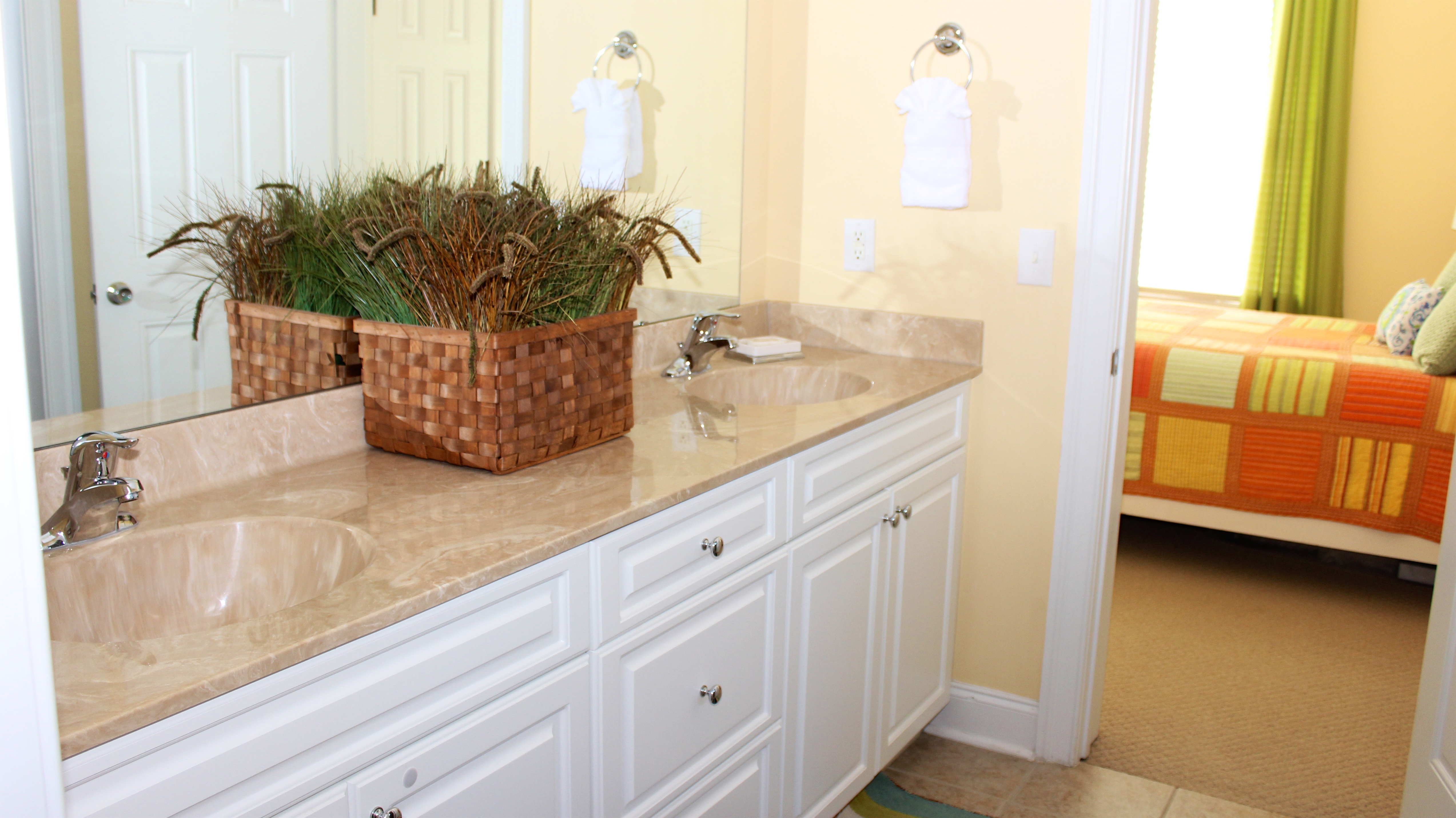 A Jack n Jill bathroom connects the two bedrooms. It has a double sink vanity.
