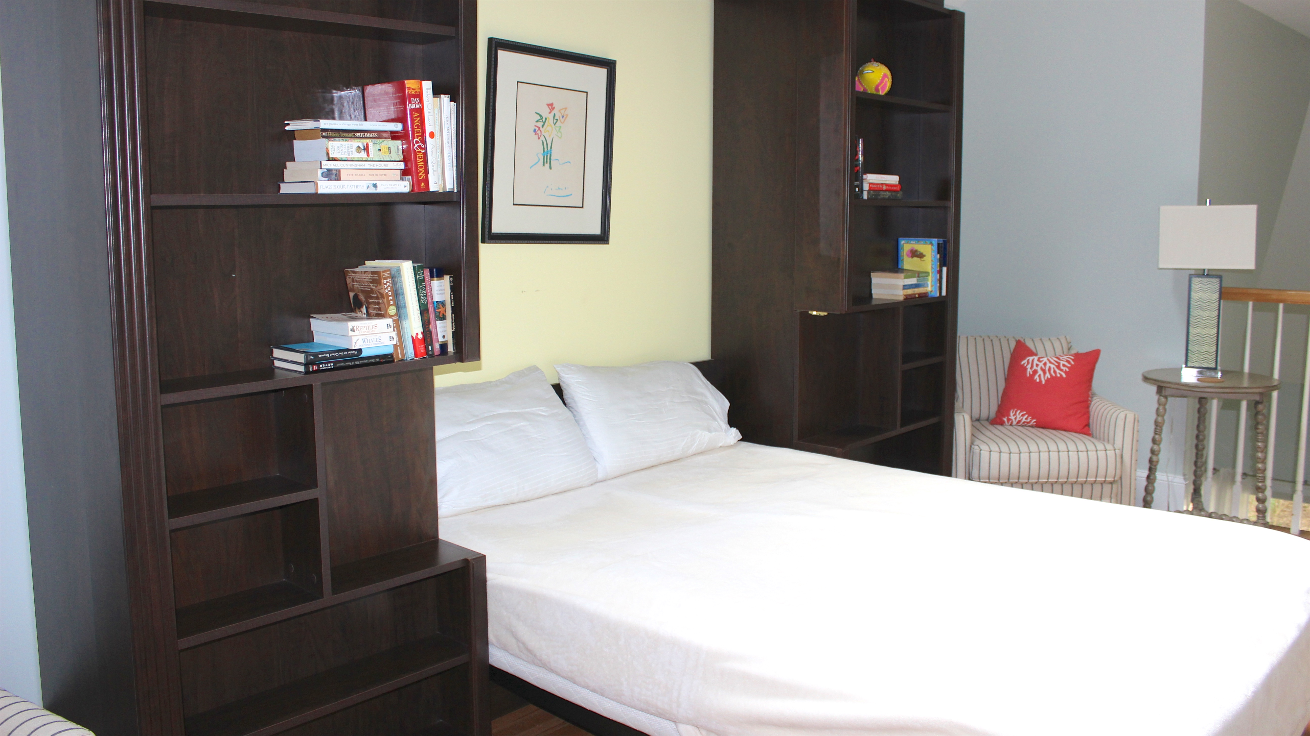The bookcase hides a queen murphy bed.