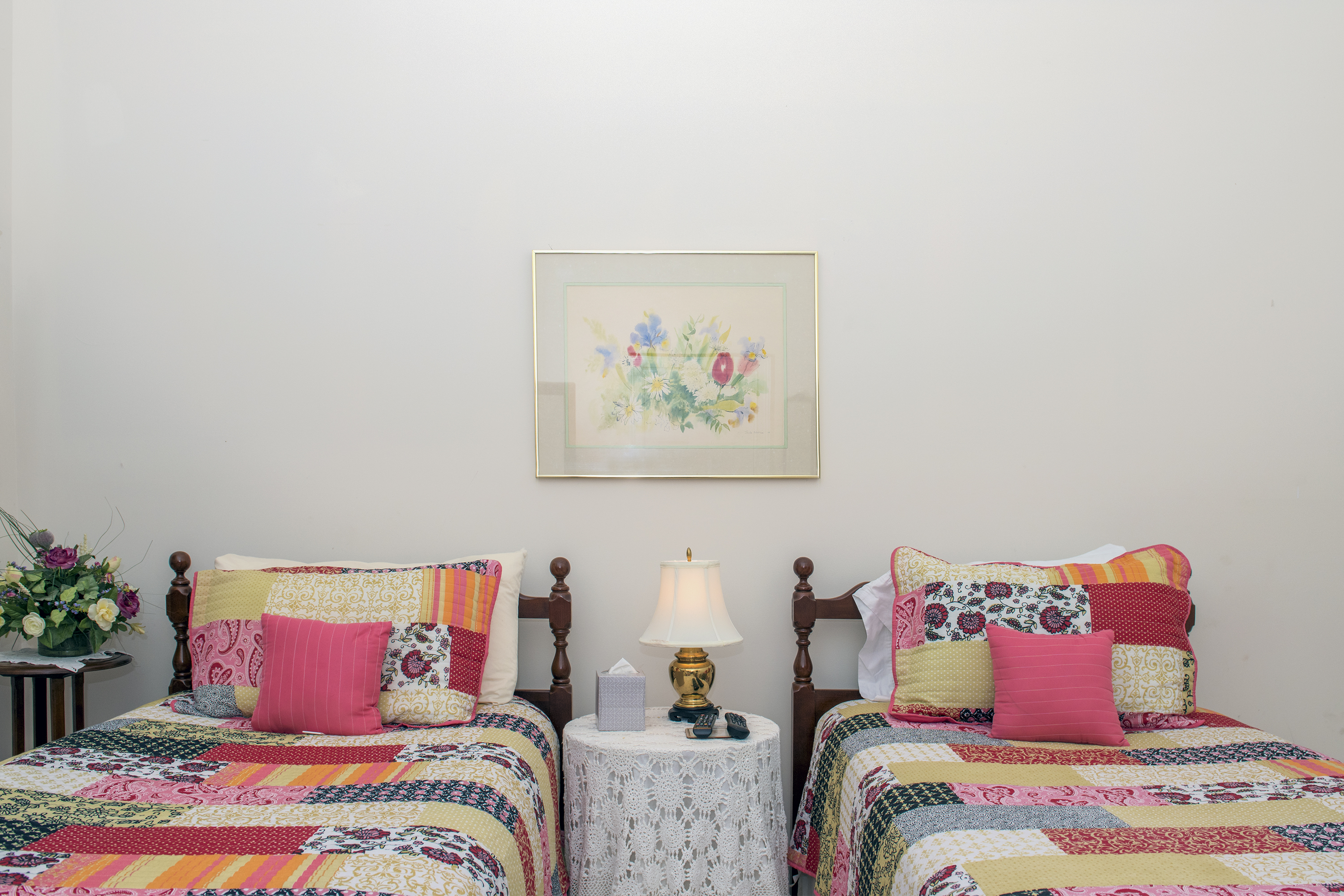 Adorable twin beds are in the first floor guest room.