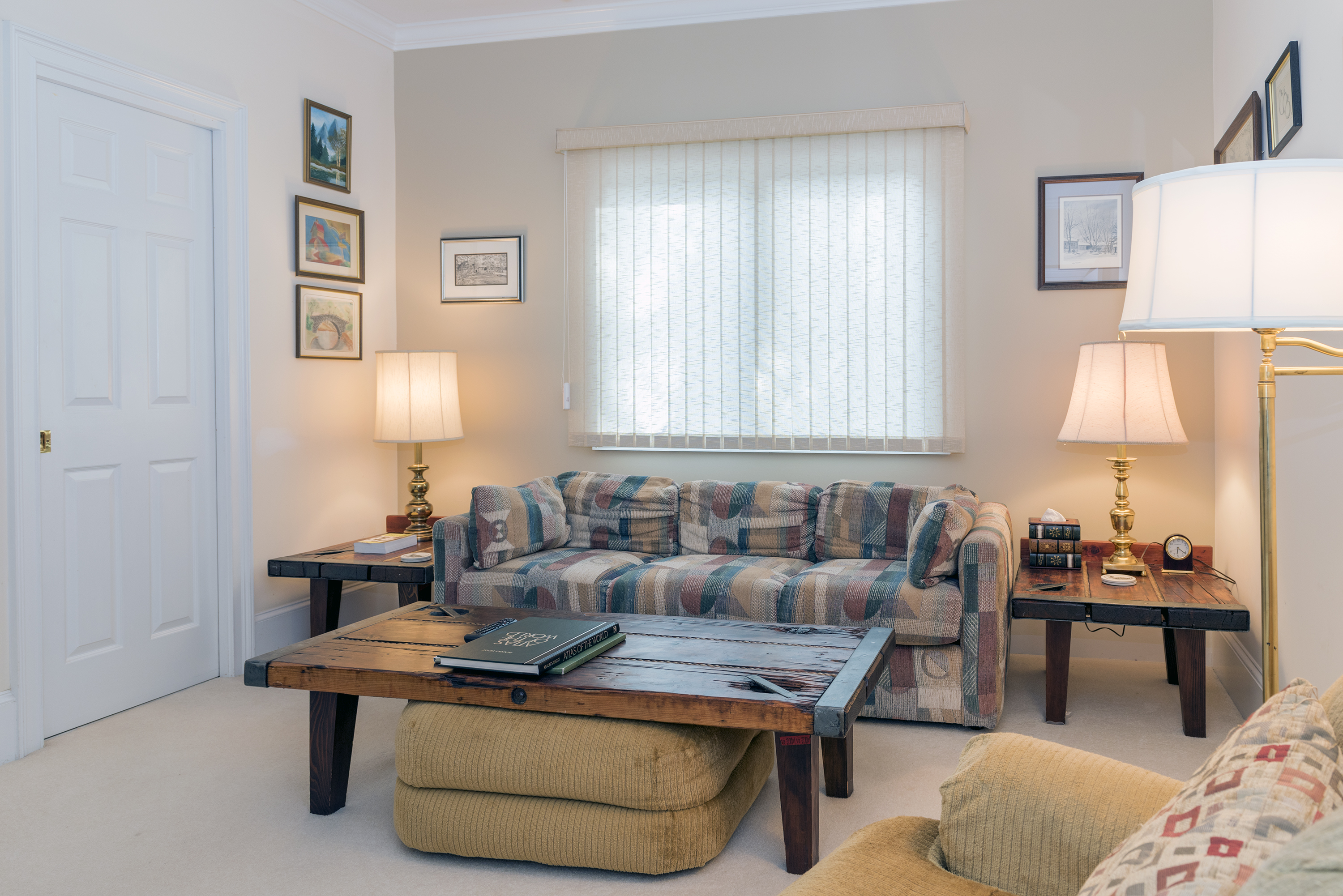 The den is located off the entry hall and has a queen sofa sleeper.