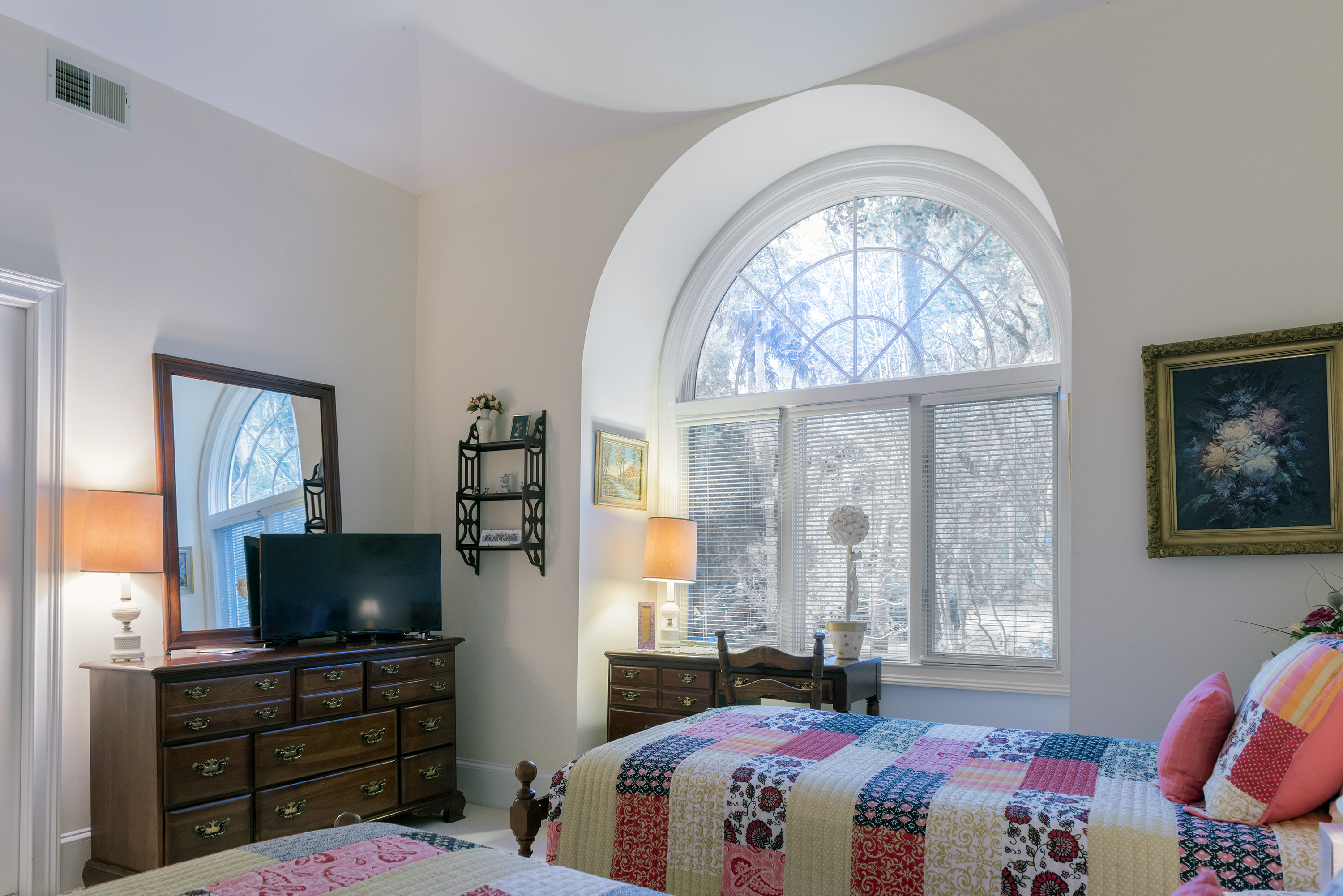 There is a new flat screen TV and a beautiful light filled Palladian window.