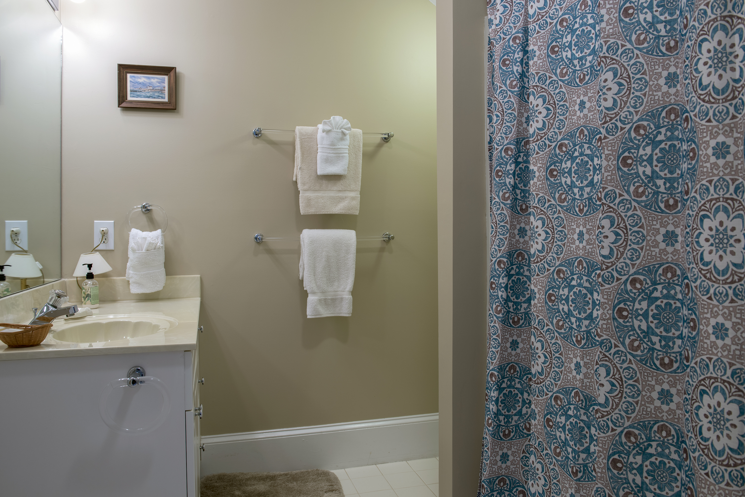 A full bath is adjacent to the king guest bedroom.