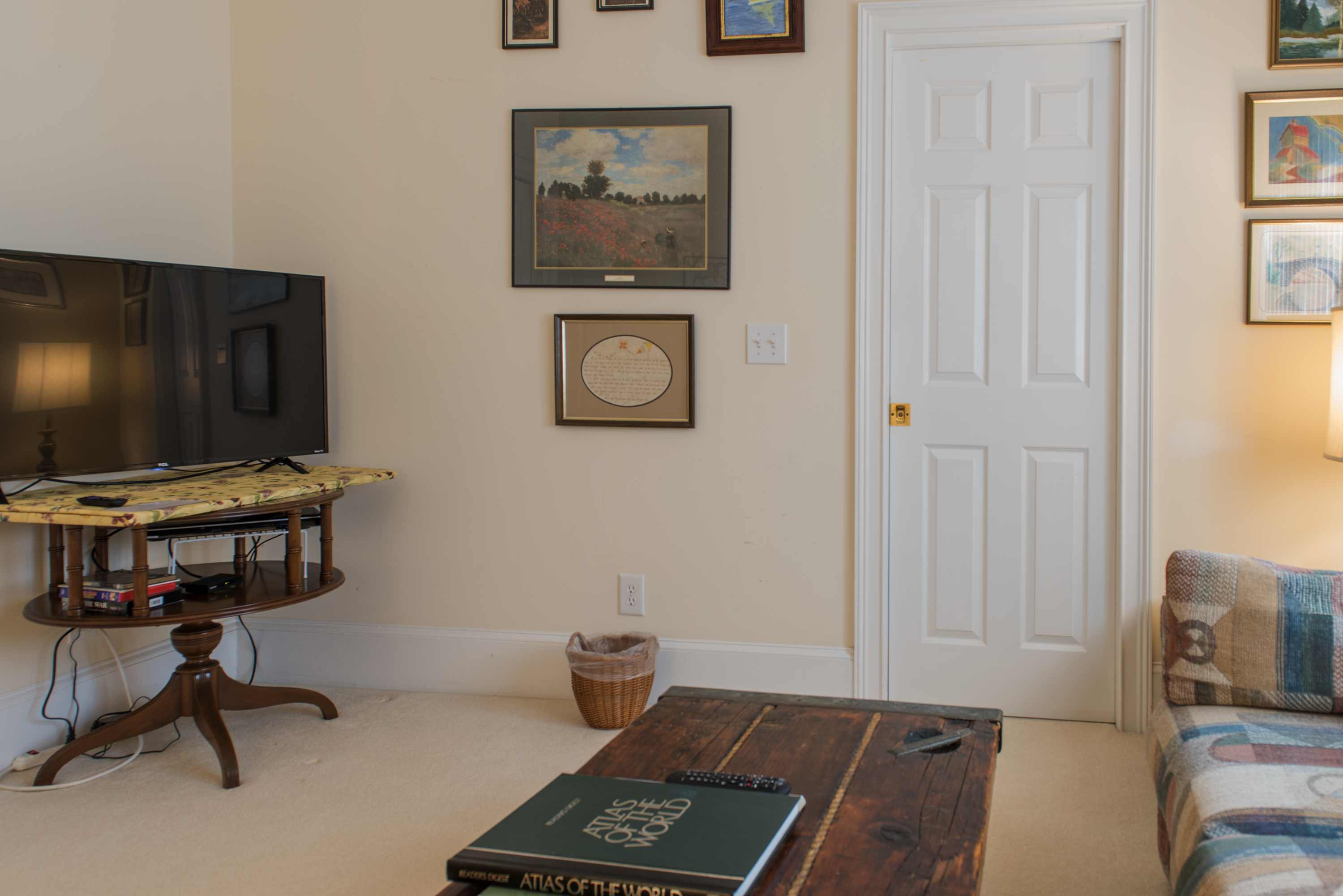 There is a large HDTV and access to the hall bath.