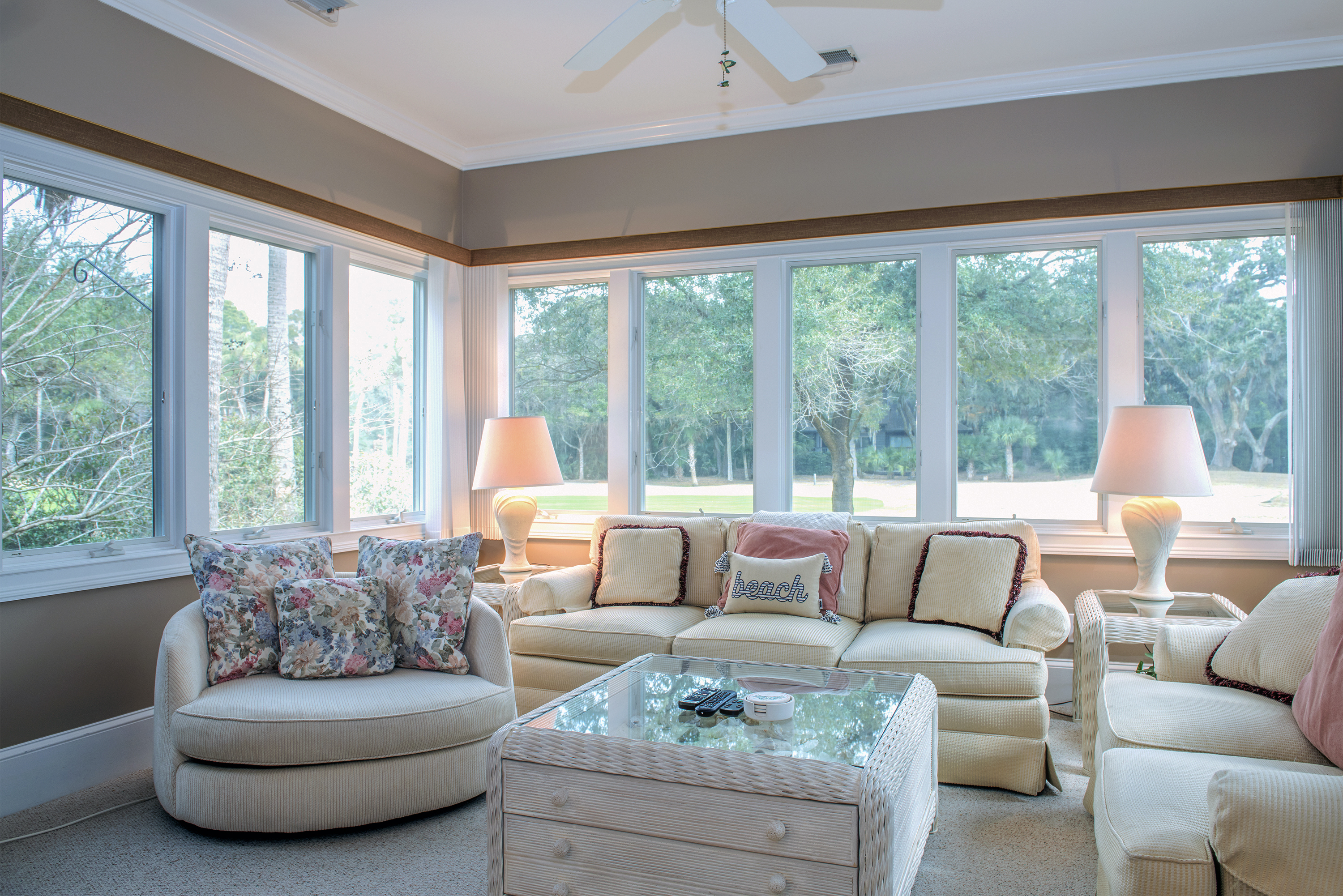 Light floods the sun room. The over-sized furniture is perfect for naps!