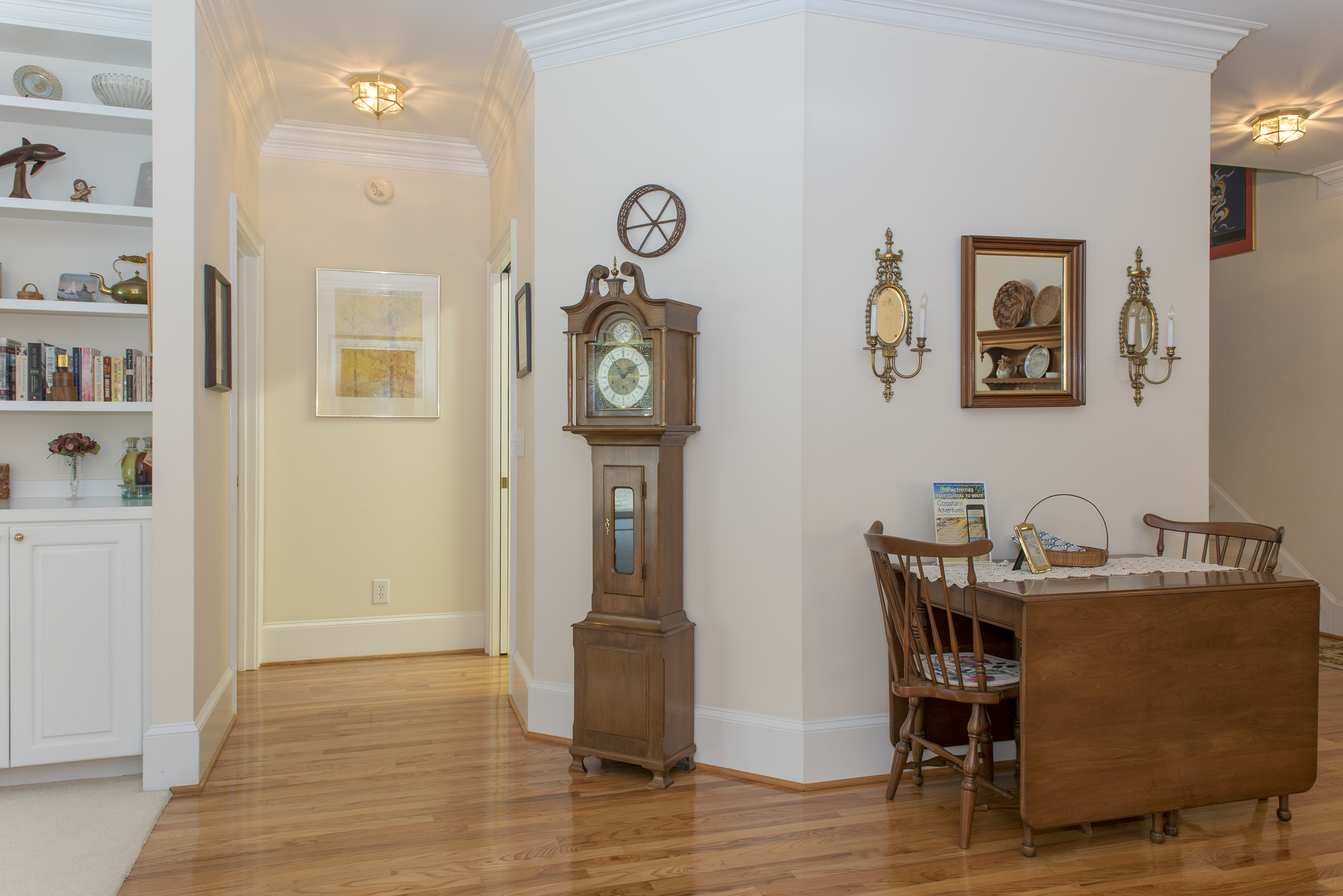 The main hall leads to the first floor bedrooms and a staircase to the remaining bedrooms.