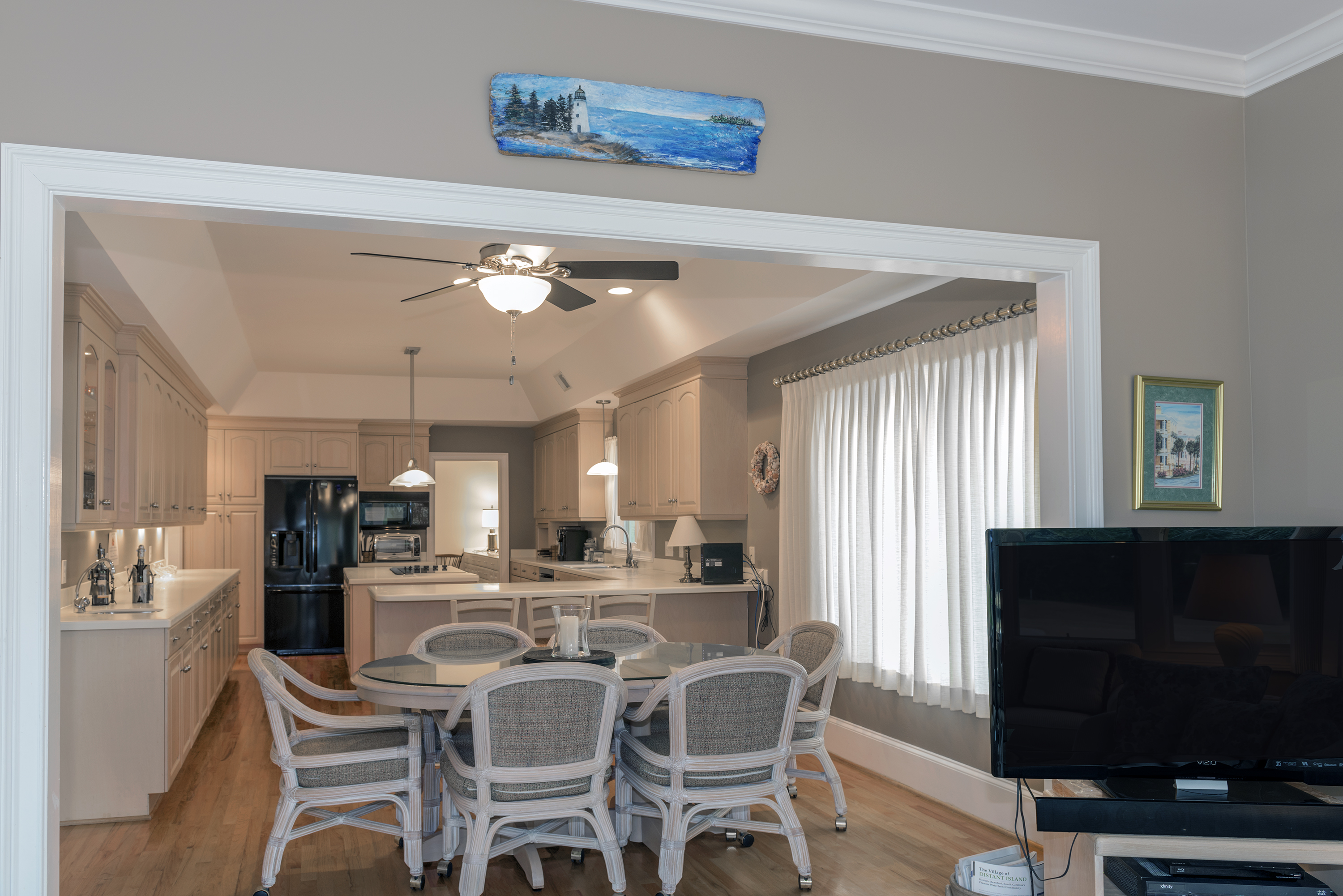 The sunroom lets you be part of the action in the kitchen.