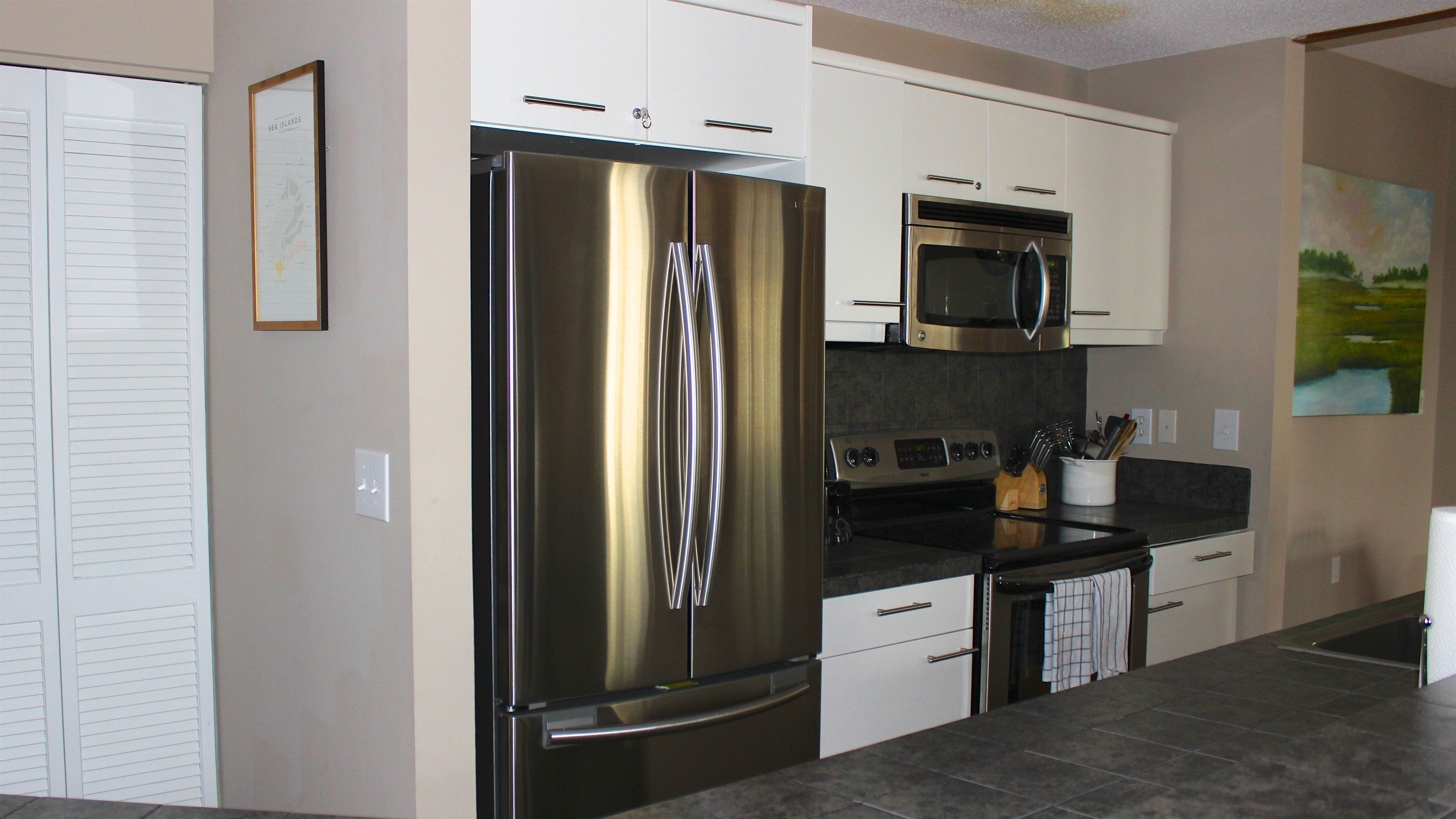 Kitchen highlights include tile counters and stainless appliances.