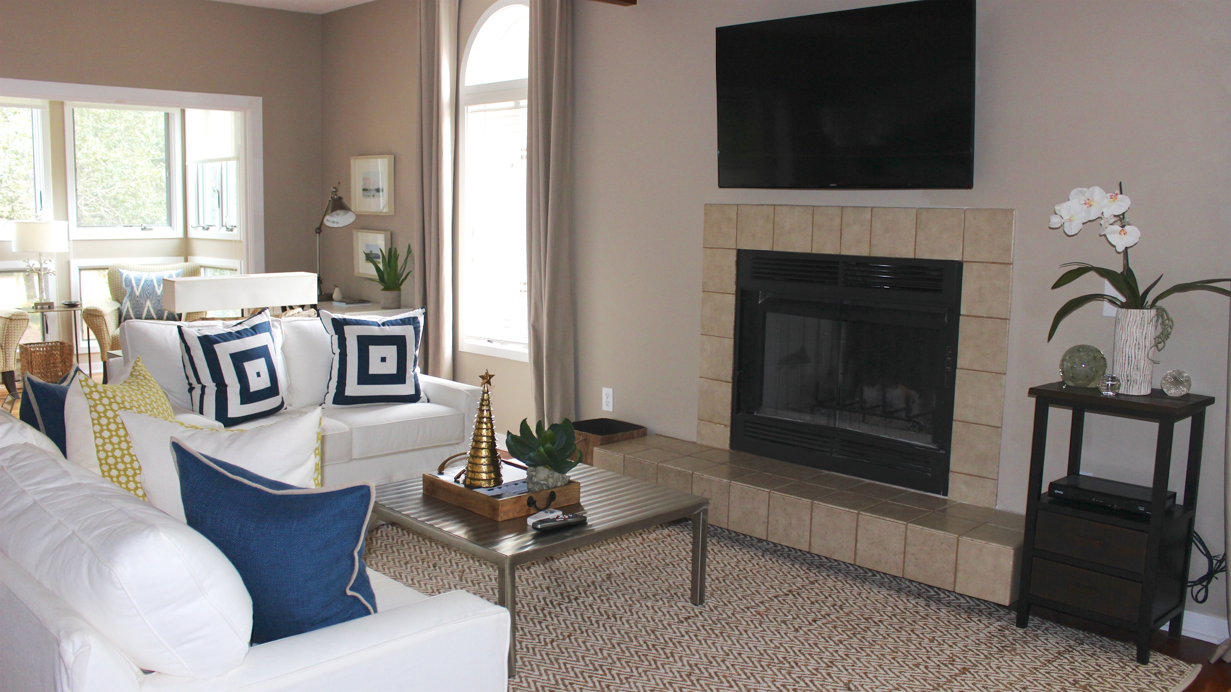 There is a large HDTV mounted over the fireplace.