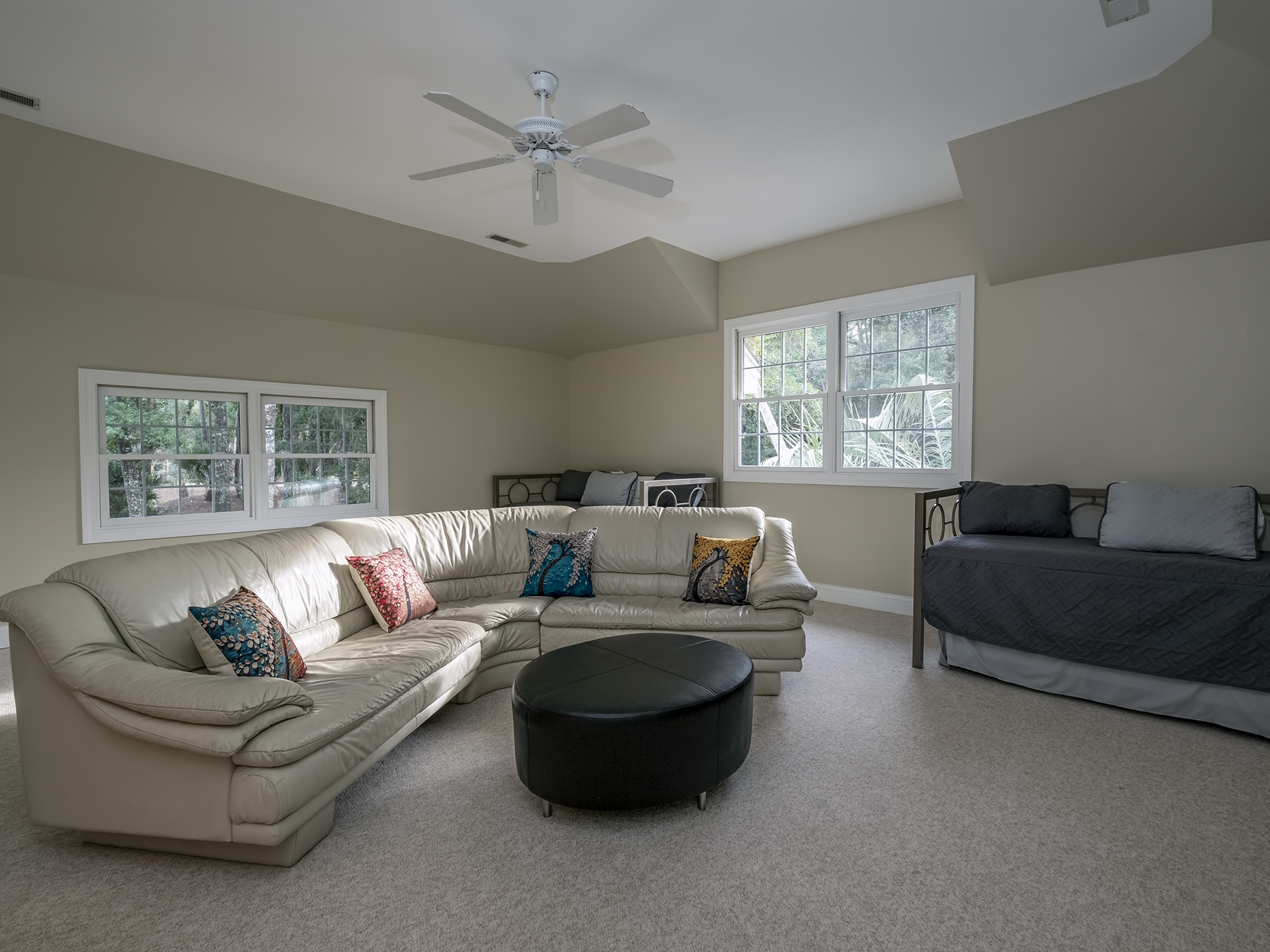 Bonus room with comfortable seating and 2 twin beds with twin trundles