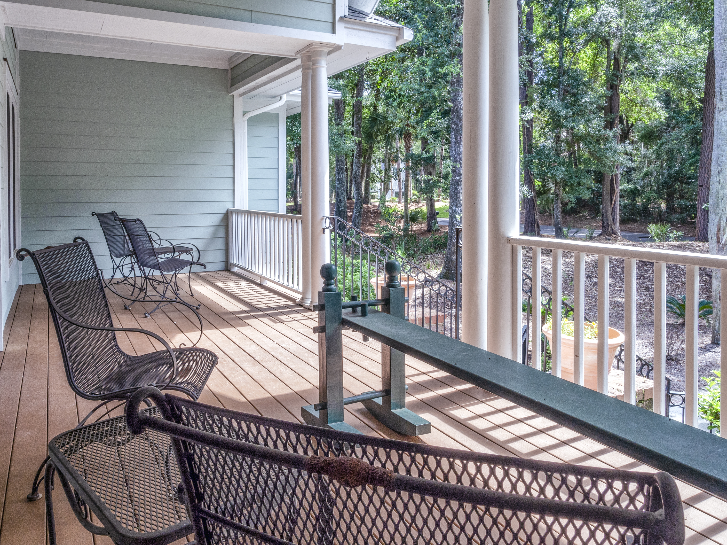 Front porch and beautiful, private lot