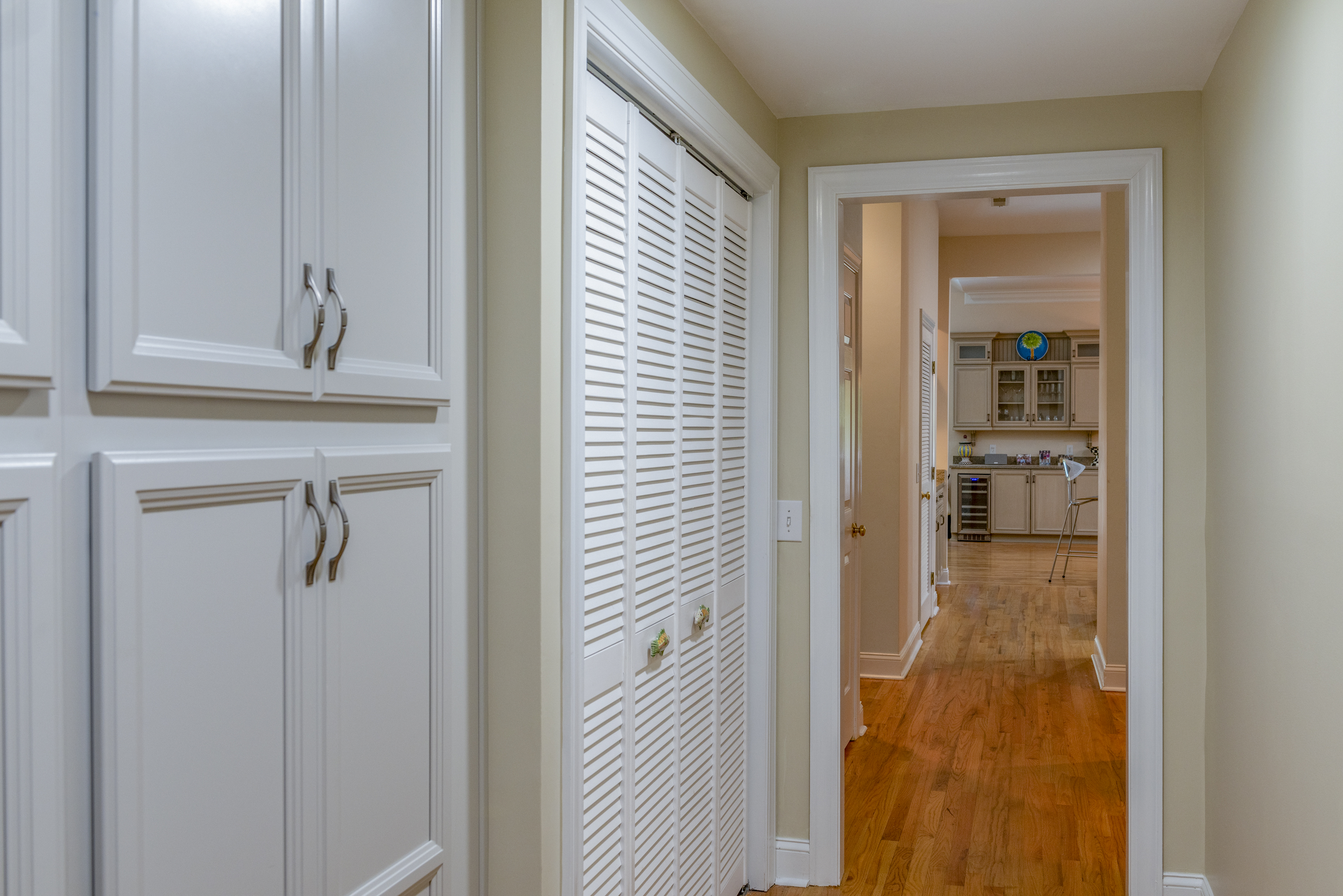 Hallway including full size washer & dryer behind bi-fold doors
