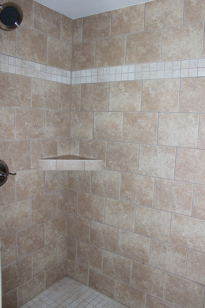 The large tiled shower is in a separate room.