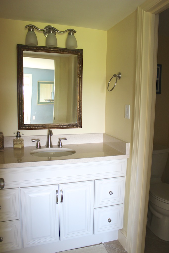 The master bath has a granite topped vanity & tiled shower in a separate room.