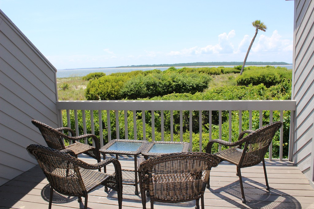 Step onto the deck to grill or relax while enjoying the dunes/ocean scenery.