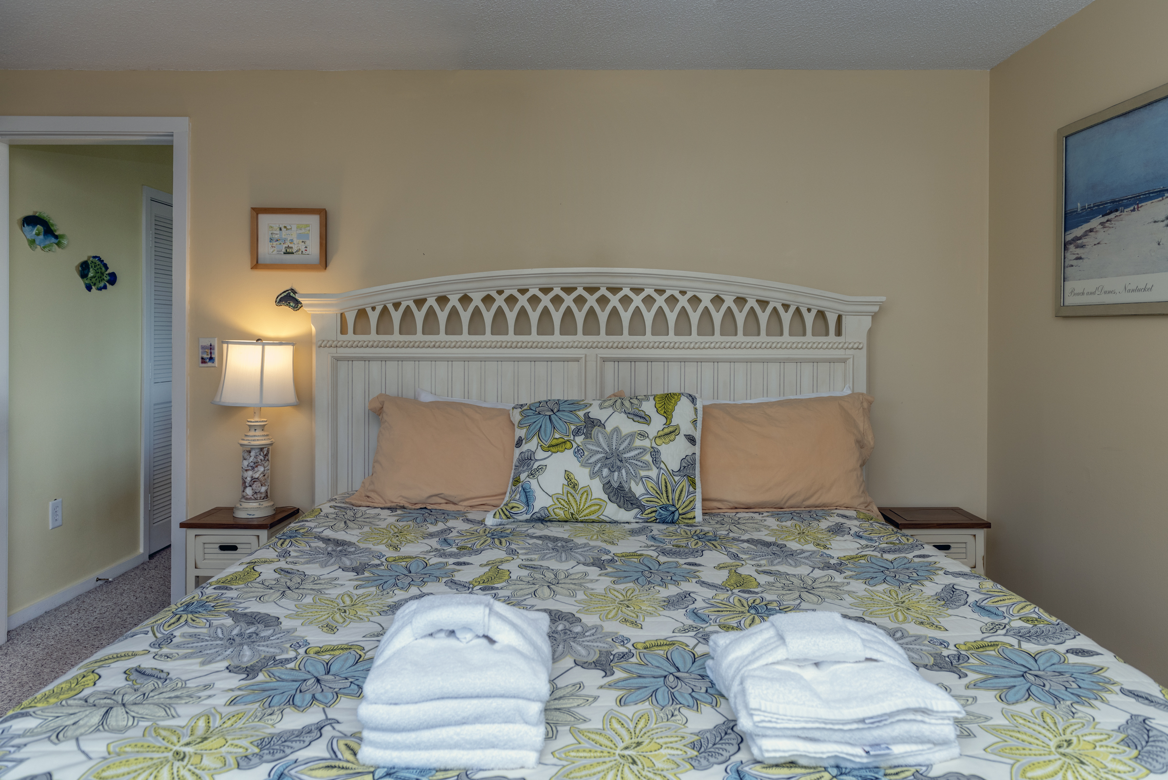 Master bedroom on first floor with king bed