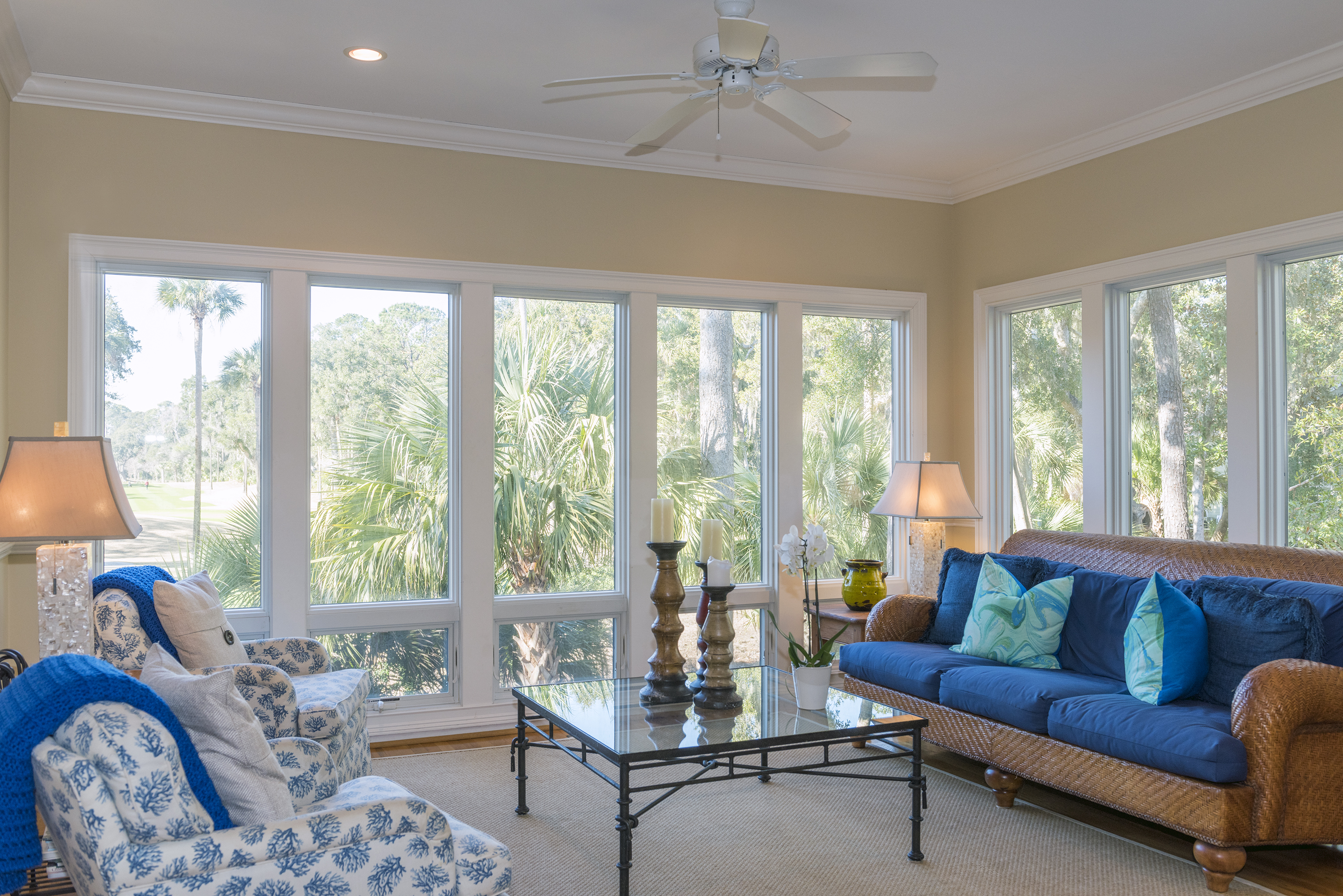The ceiling to floor windows in the sun room offer beautiful views of the outdoor landscaping.