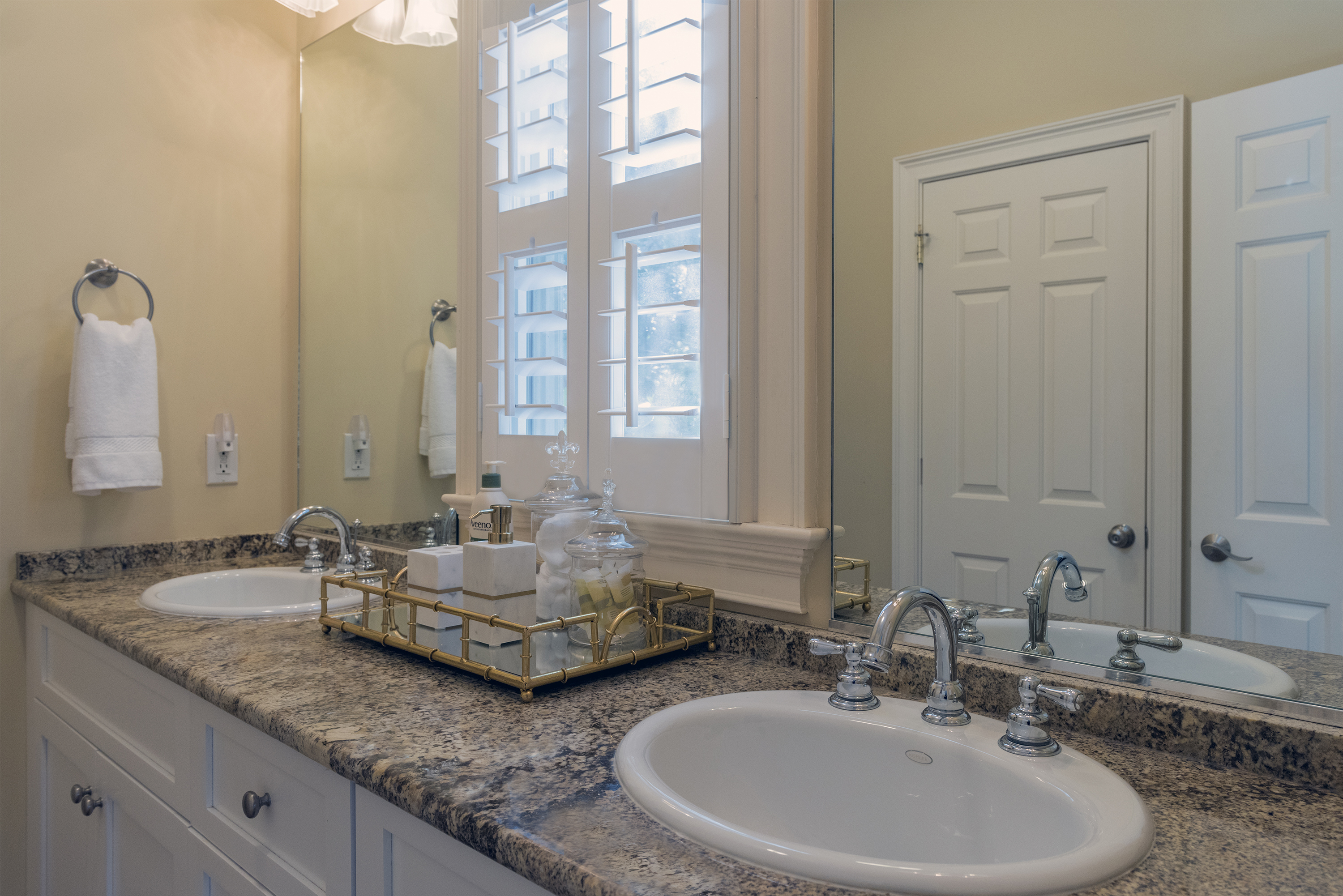 The double sink vanity in the master bath is flanked by windows for plenty of natural light.