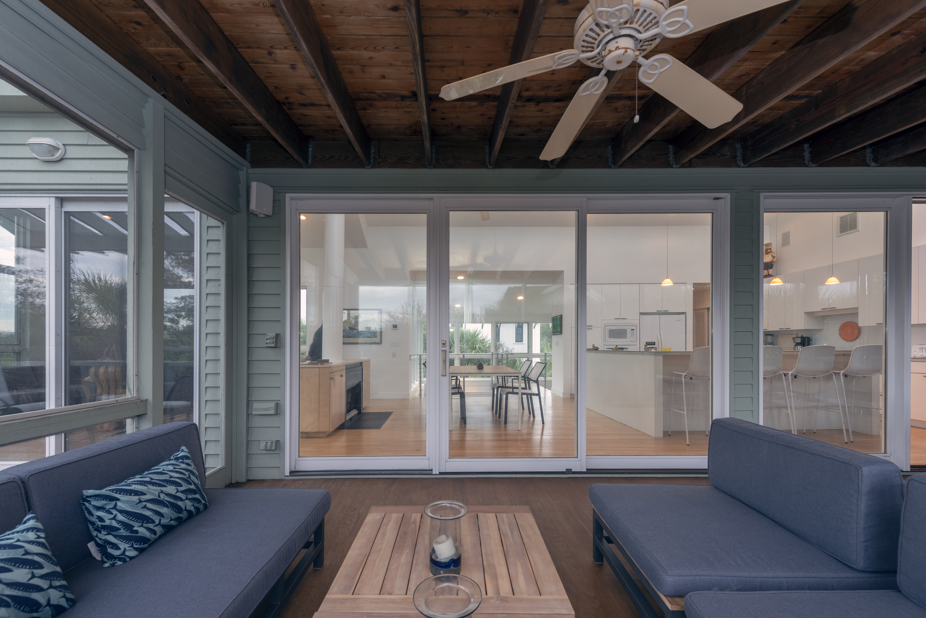 Conversation seating on the screened porch