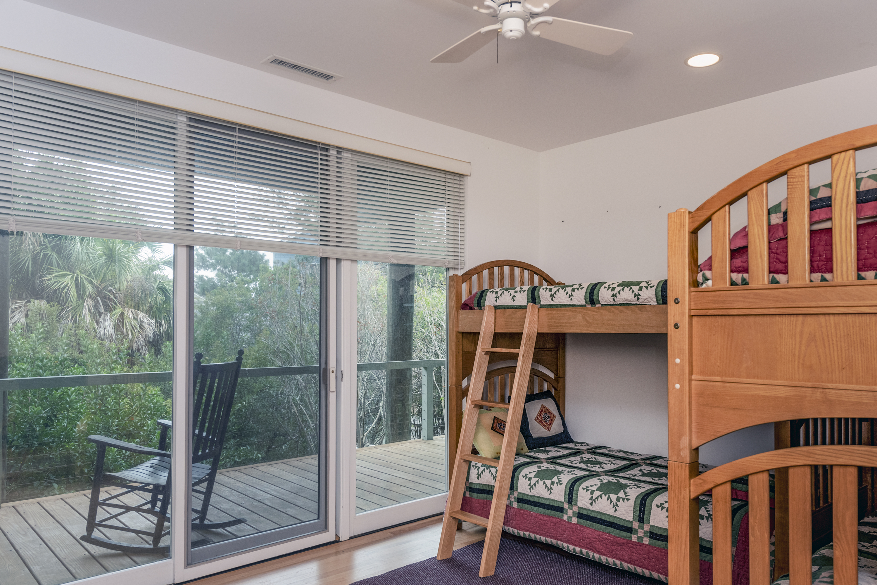Guest room with 2 bunk beds and access to deck