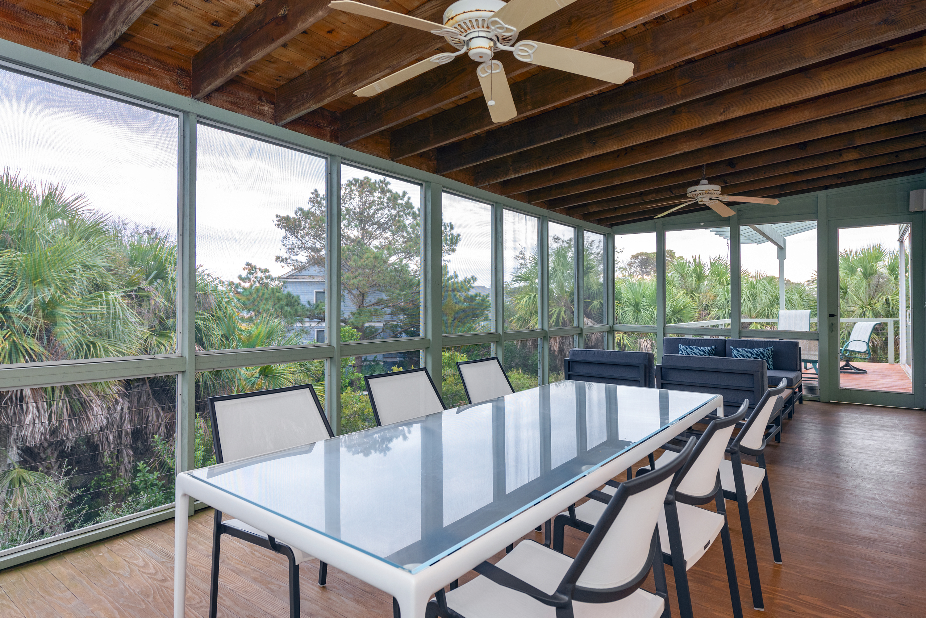 Scenic al fresco dining and conversation seating on the screened porch