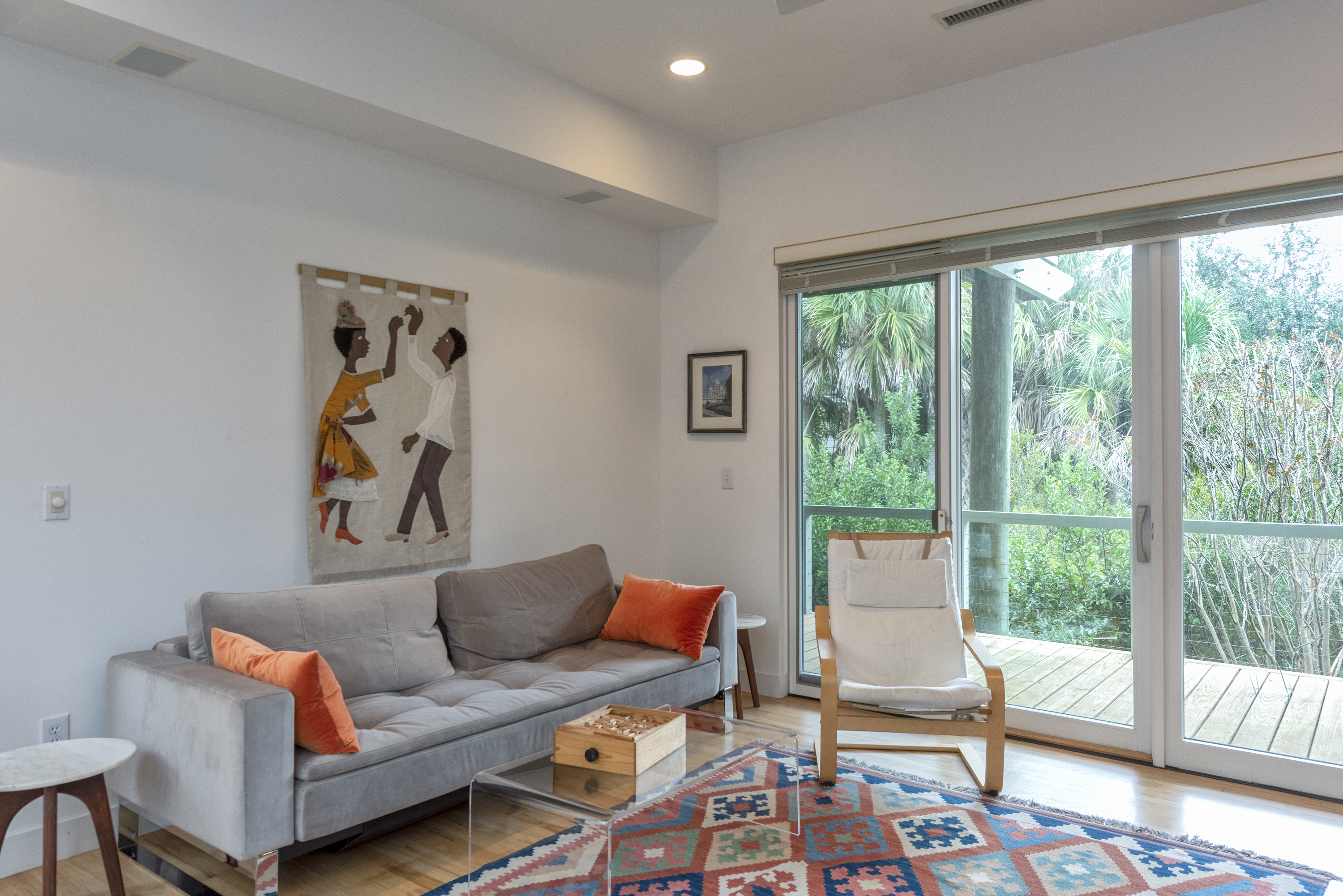 Sliding doors leading to open deck. A comfortable pull-out full sofa bed is featured.