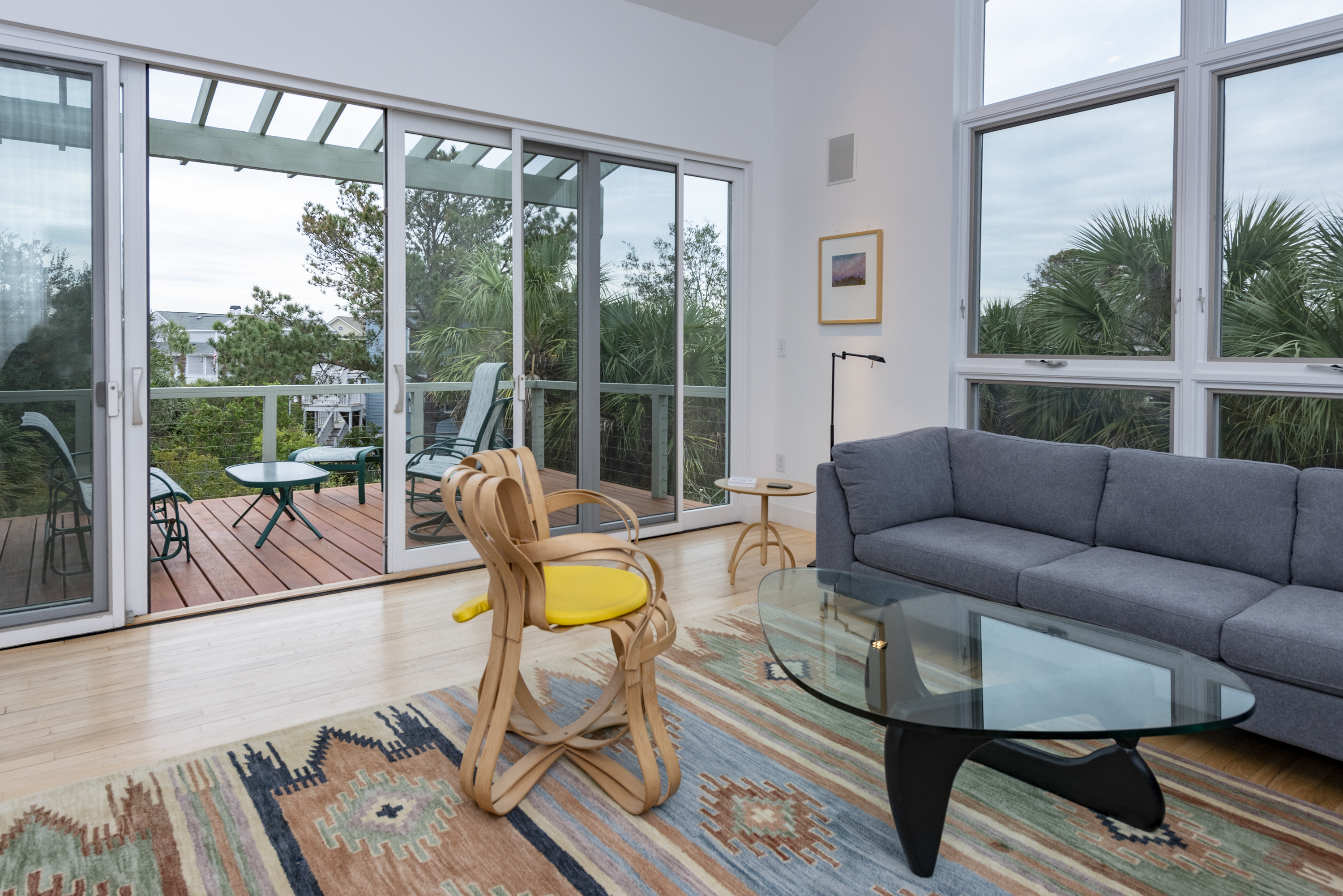 Upper level living room with deck access and ocean views
