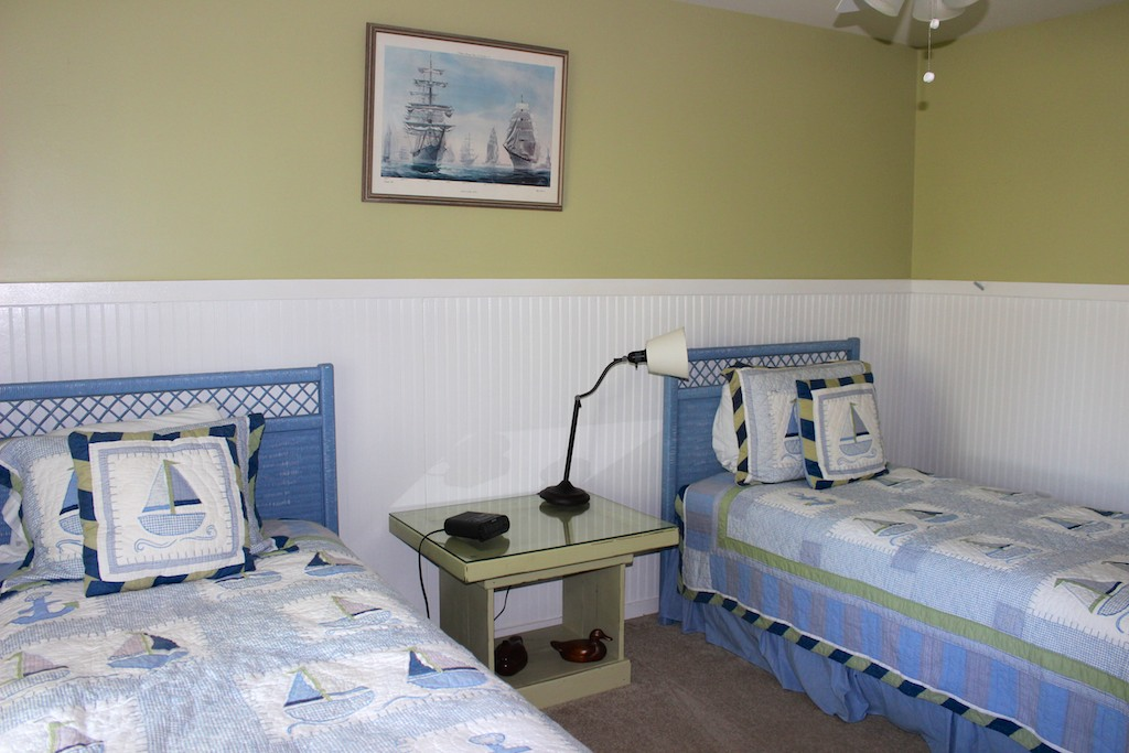 Crisp white wainscoting & nautical features remind you that you are by the sea.