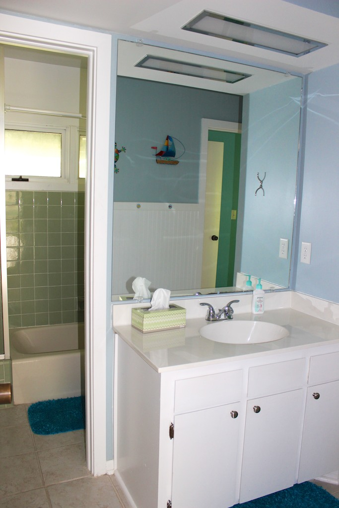 The hall bath has a separate sink area and shower/tub.