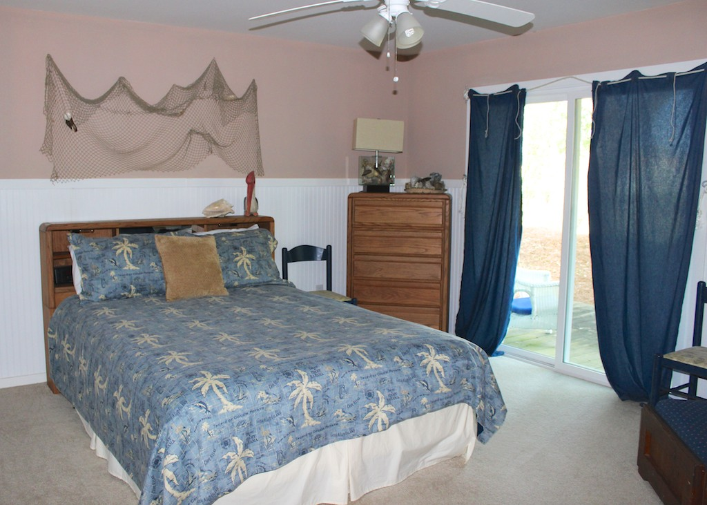Head up a half flight of stairs to the 2nd BR. It has a queen bed & deck access.