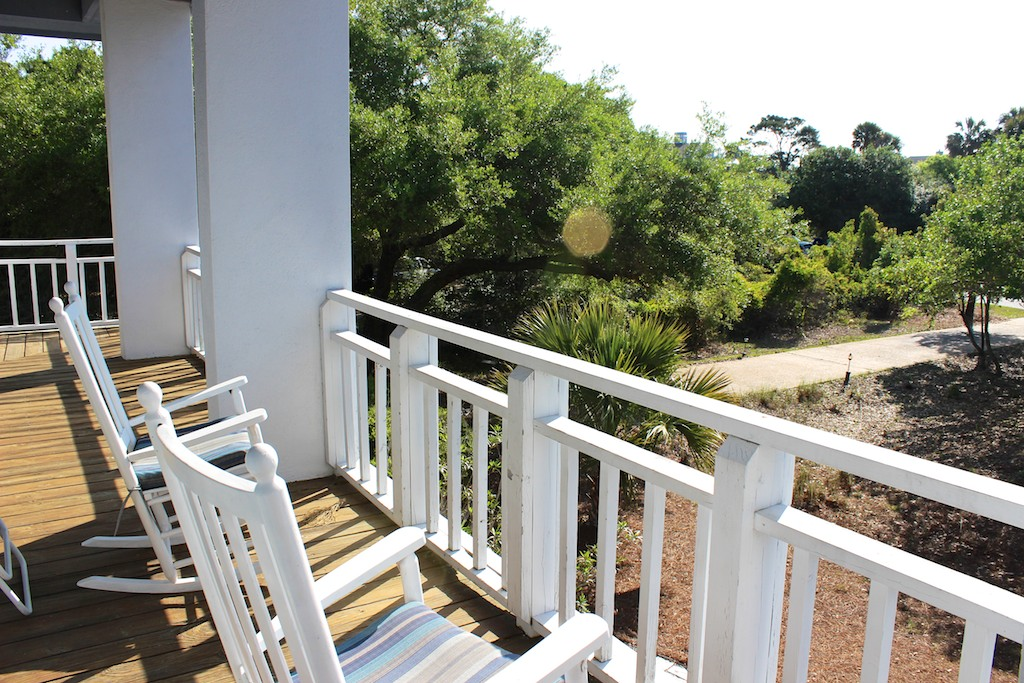 Sliding doors lead to a deck lined with rockers.
