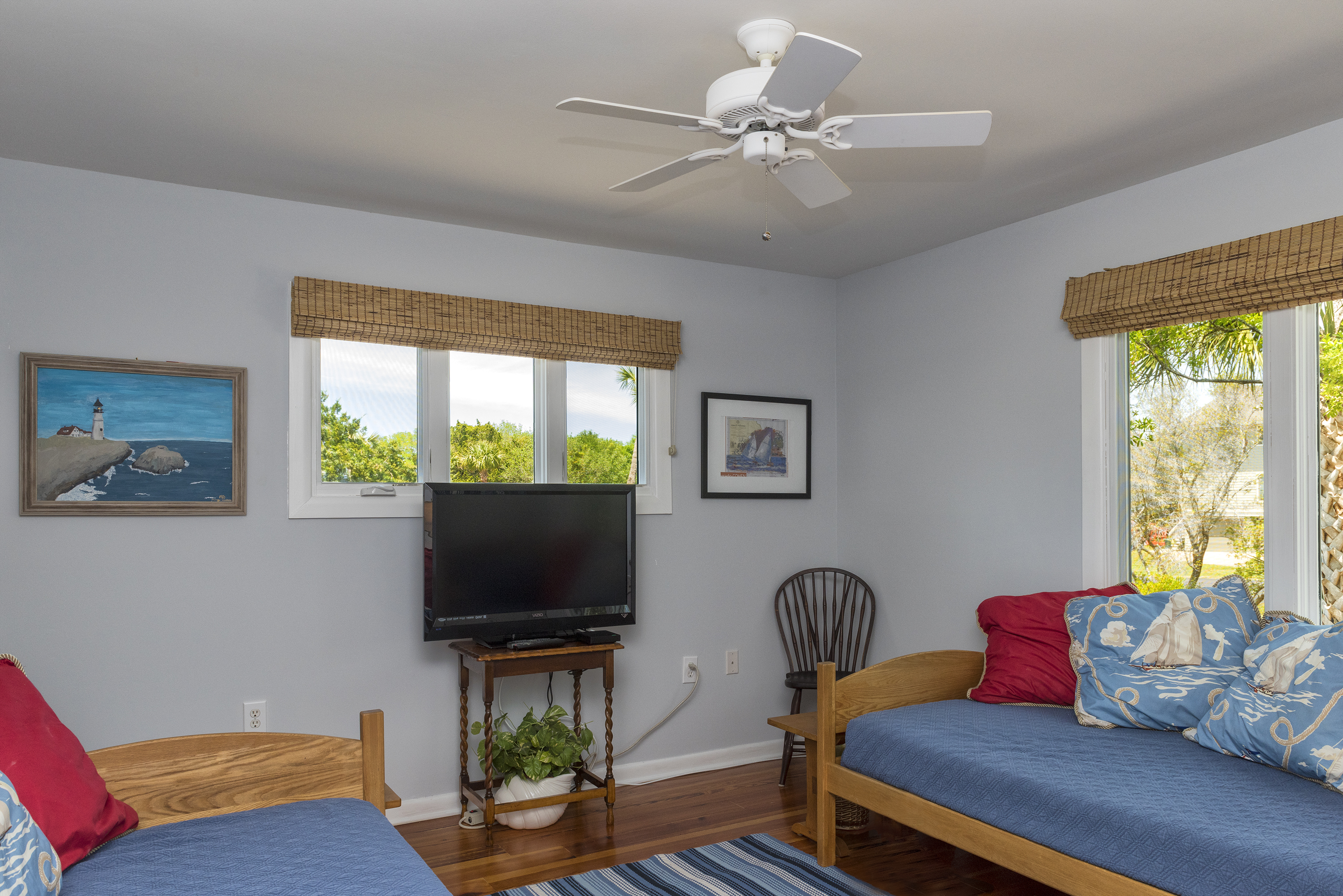 The 2nd bedroom on the 1st floor also has two twin beds and large TV.