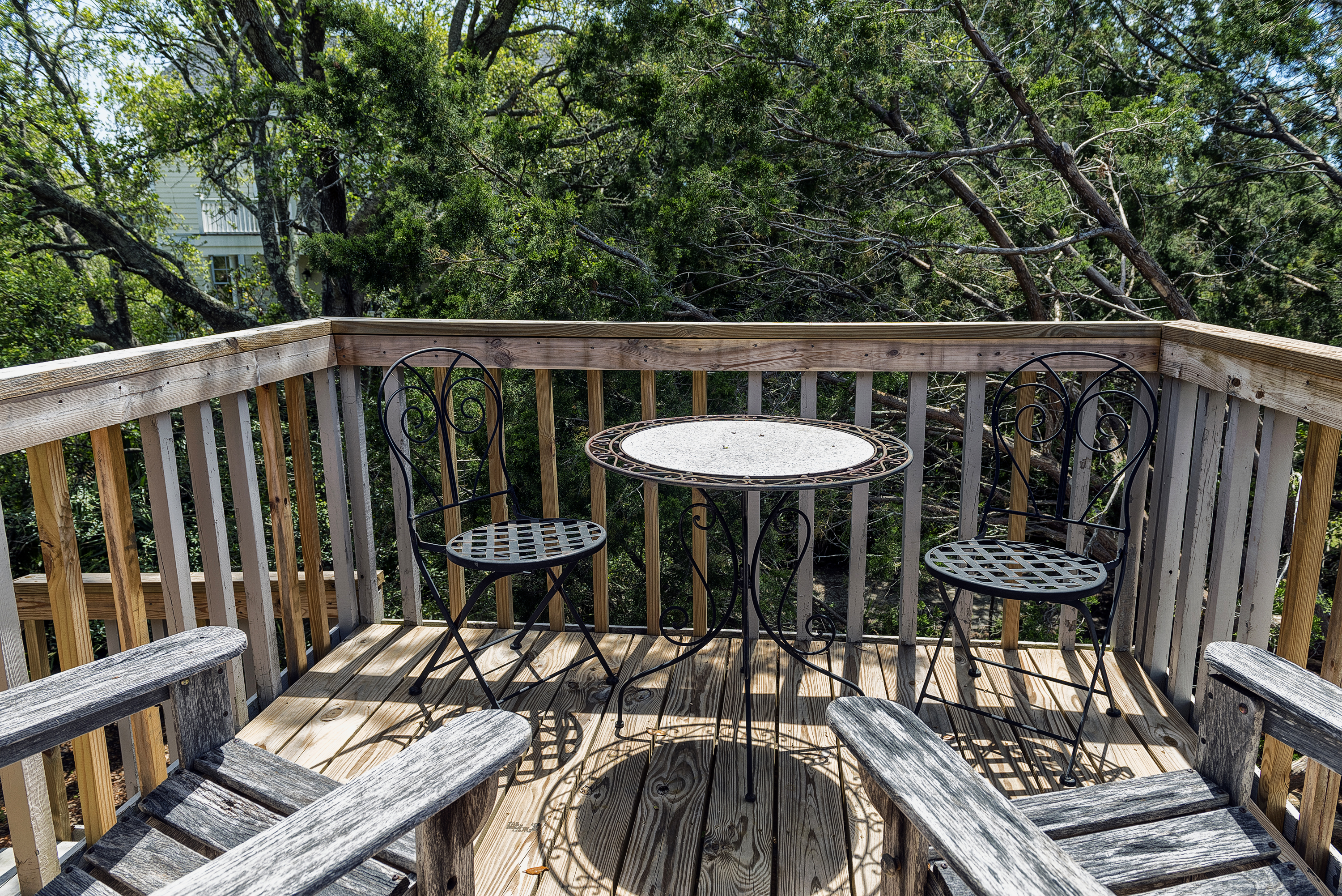 Doors in the master lead to a deck with chairs and a bistro table, perfect for a morning cup of coffee.  Stairs lead down to the beach path.