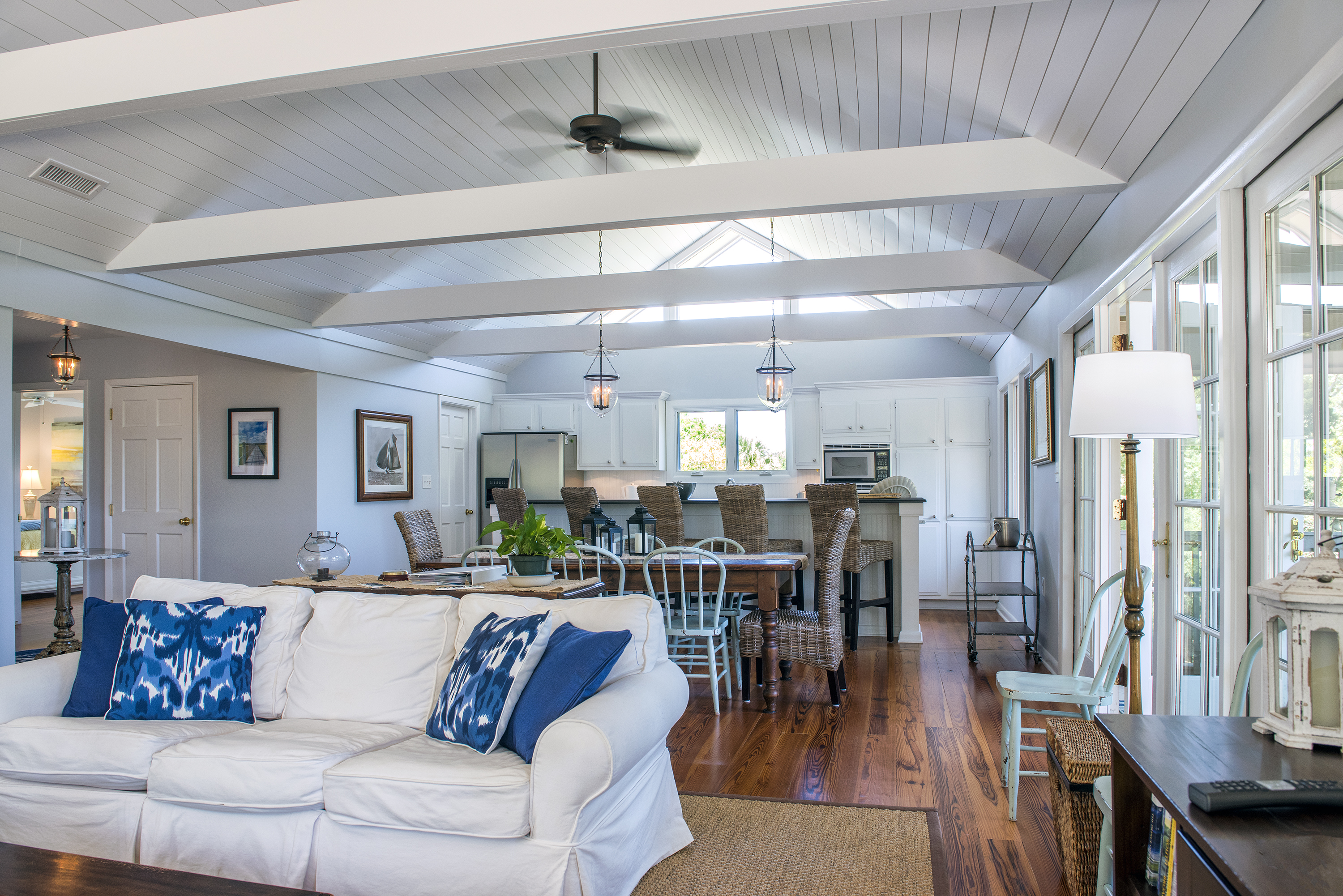 Open living area with decks and screened porch access.