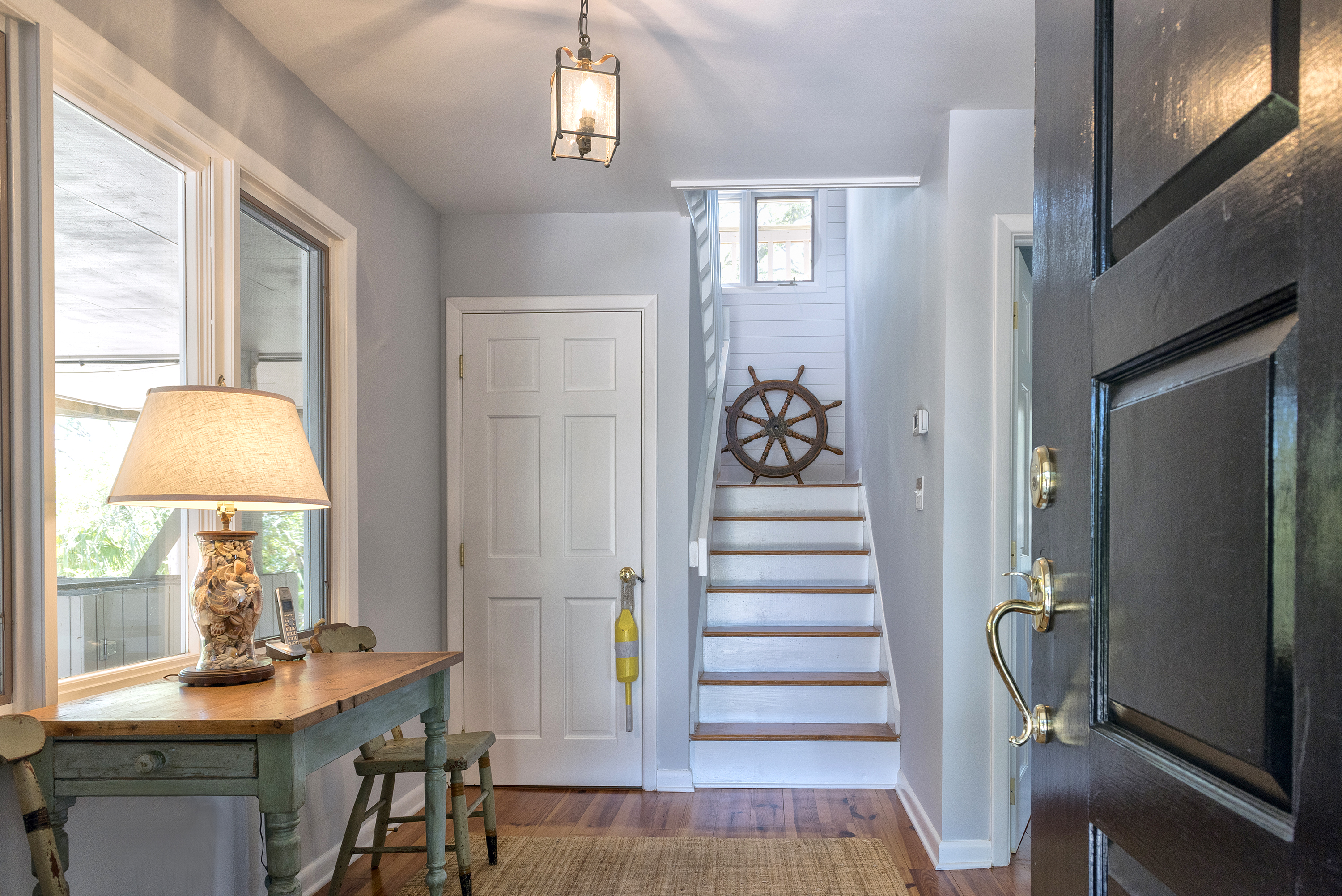 This reverse floor plan home has a beachy feel throughout.