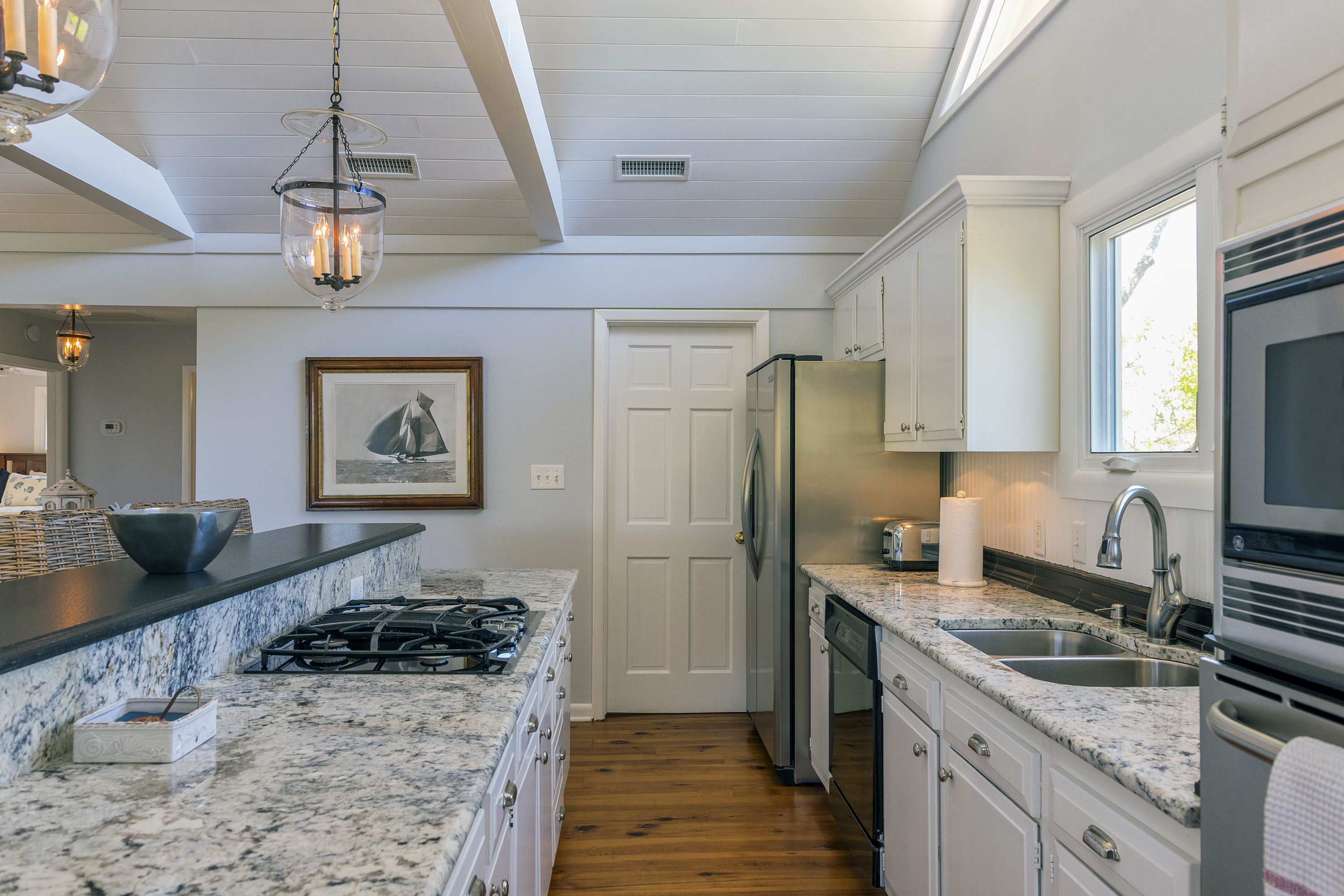 Stainless steel appliances enhance this fabulous kitchen.  The laundry room is off the kitchen.