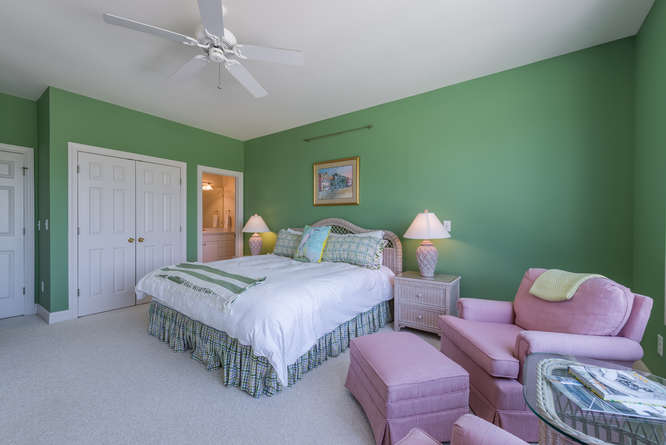 The 1st BR has a king bed and TV. It has views of the pool and golf course.