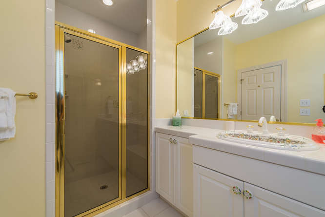 The attached full bath has a shower and large vanity.