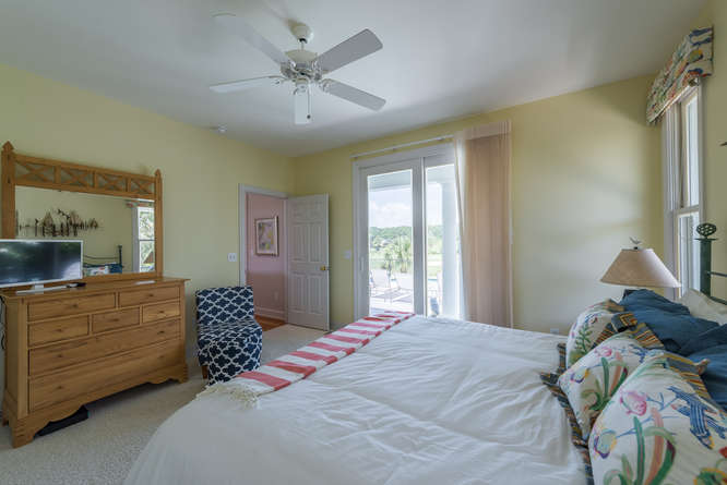There is a TV and access to the backyard deck from this bedroom.