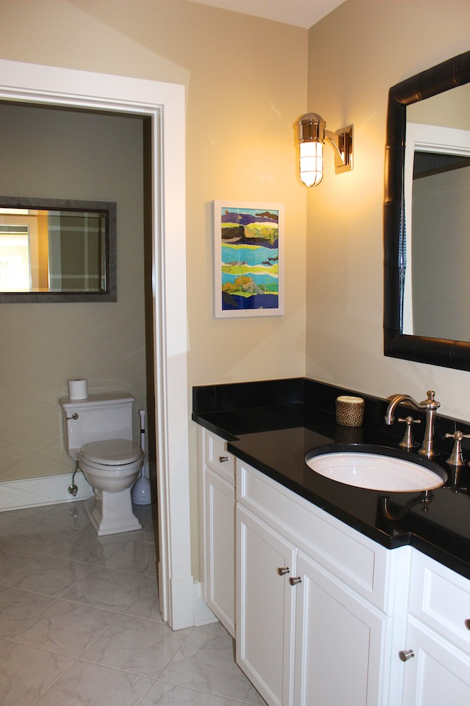 The attached bathroom has black granite counters & is also accessible from the hall.