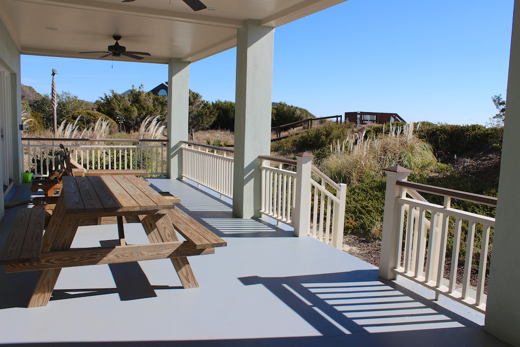 French doors lead to the covered deck where you can sit at the picnic tables.