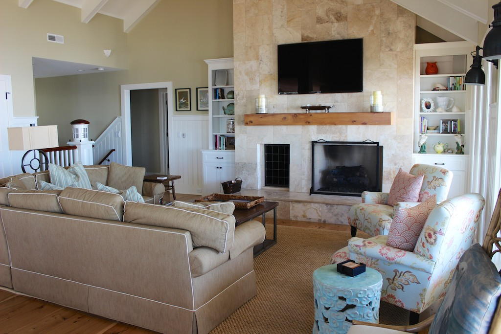 There is a granite fireplace, large HDTV, high ceilings and hardwood flooring.