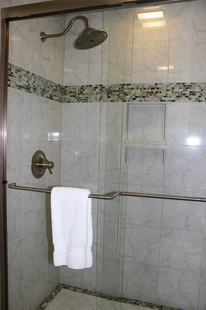 There is a large tiled shower in this bathroom.