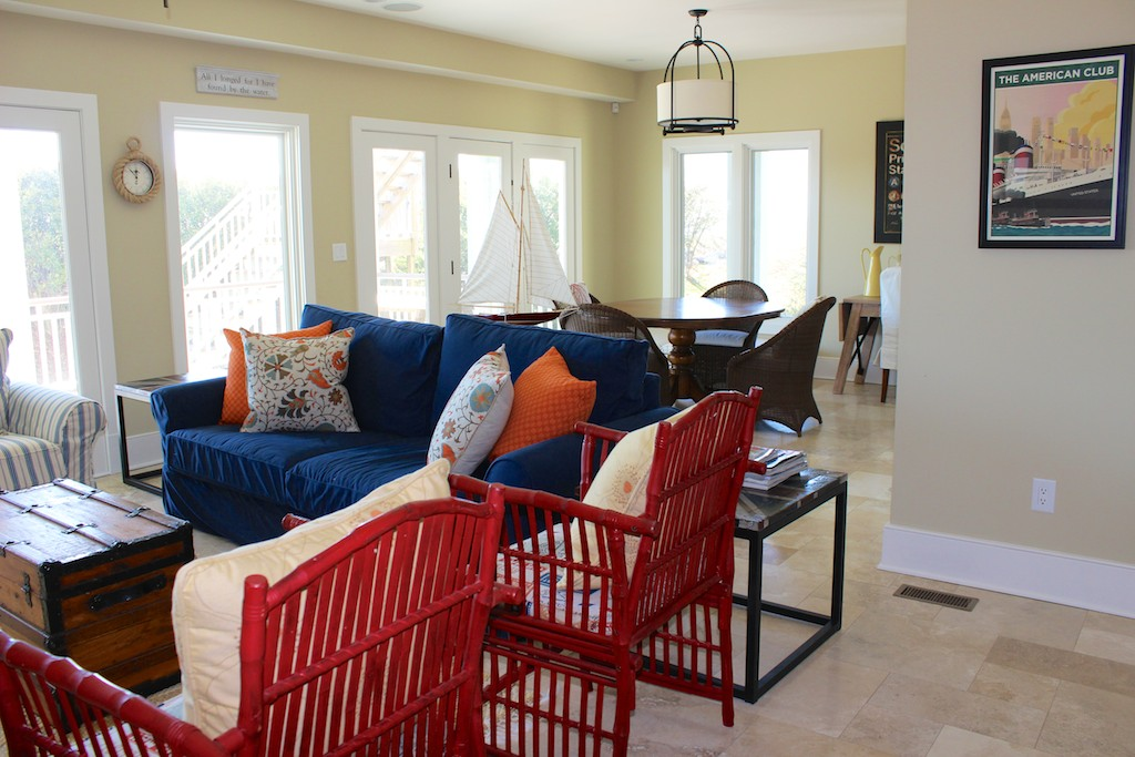 On the lower level is a family room with a game table and access to a covered porch.